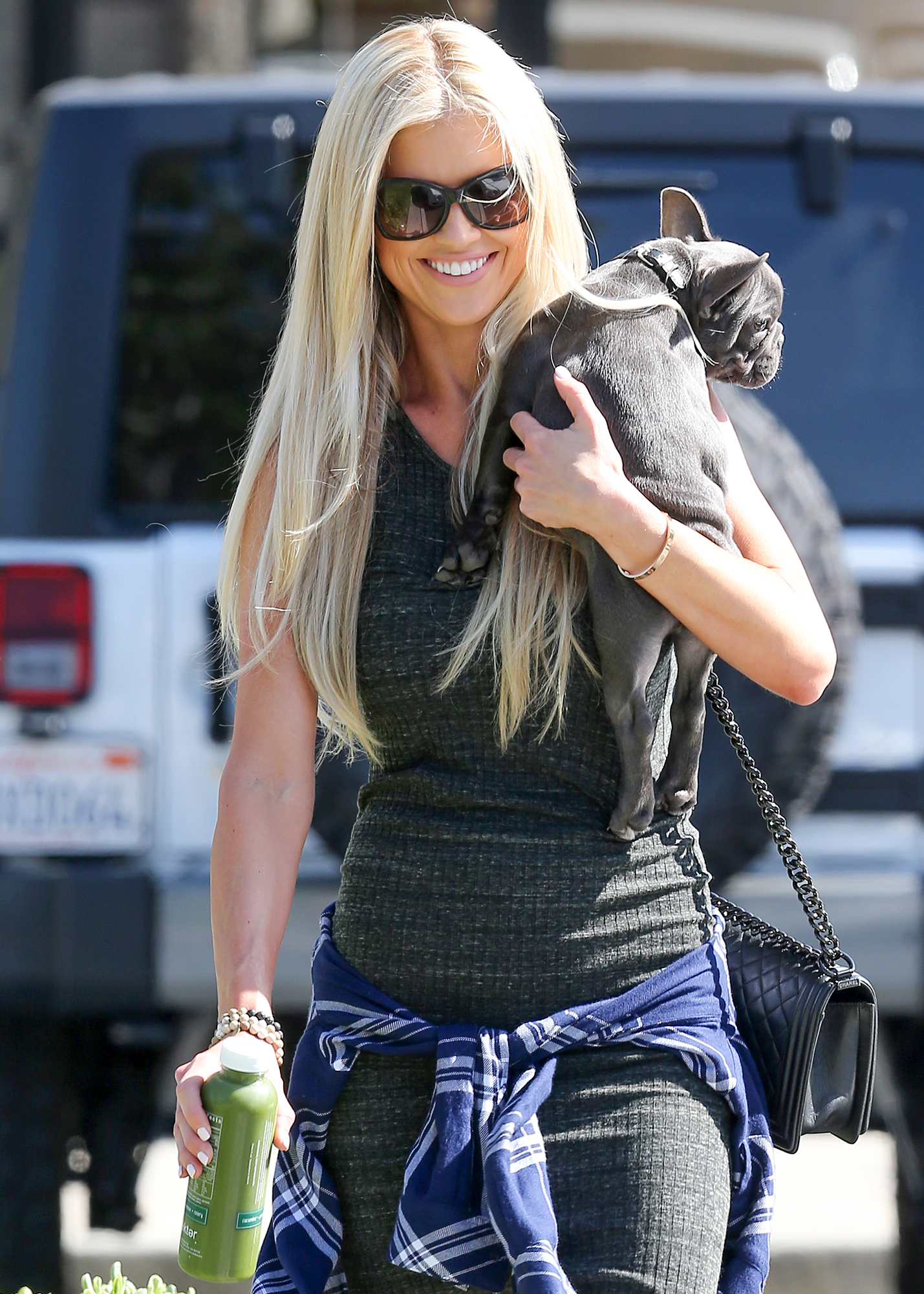EXCLUSIVE: Christina El Moussa picks up a green juice with her dog Cash