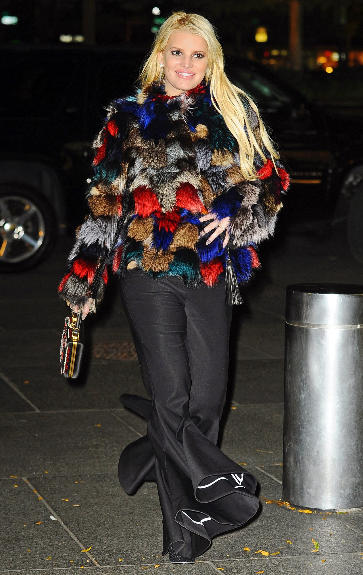 Jessica Simpson looks stunning in a colorful fur coat in New York City.