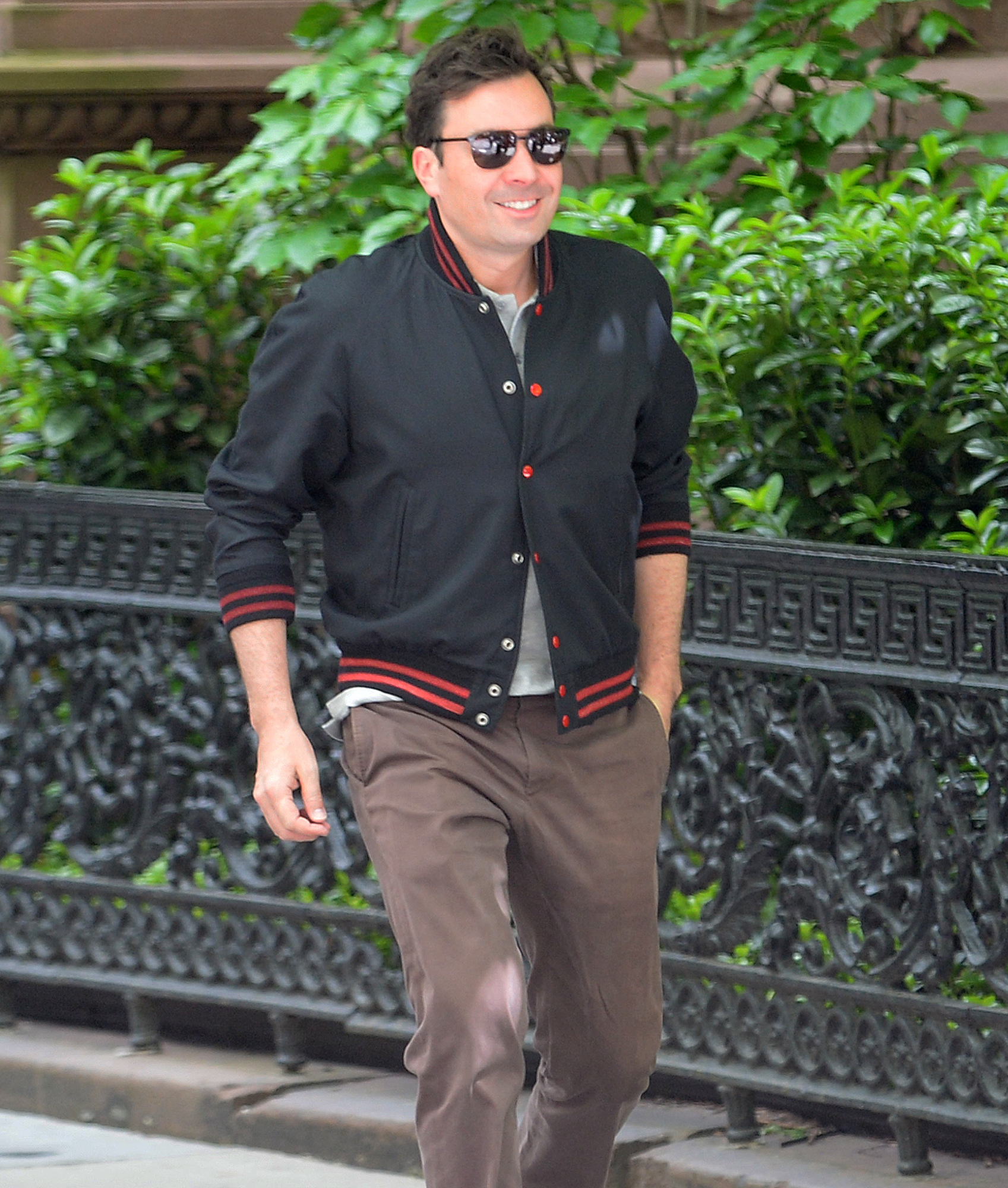 EXCLUSIVE: Jimmy Fallon flashes a smile on his way to work at The Tonight Show in New York.