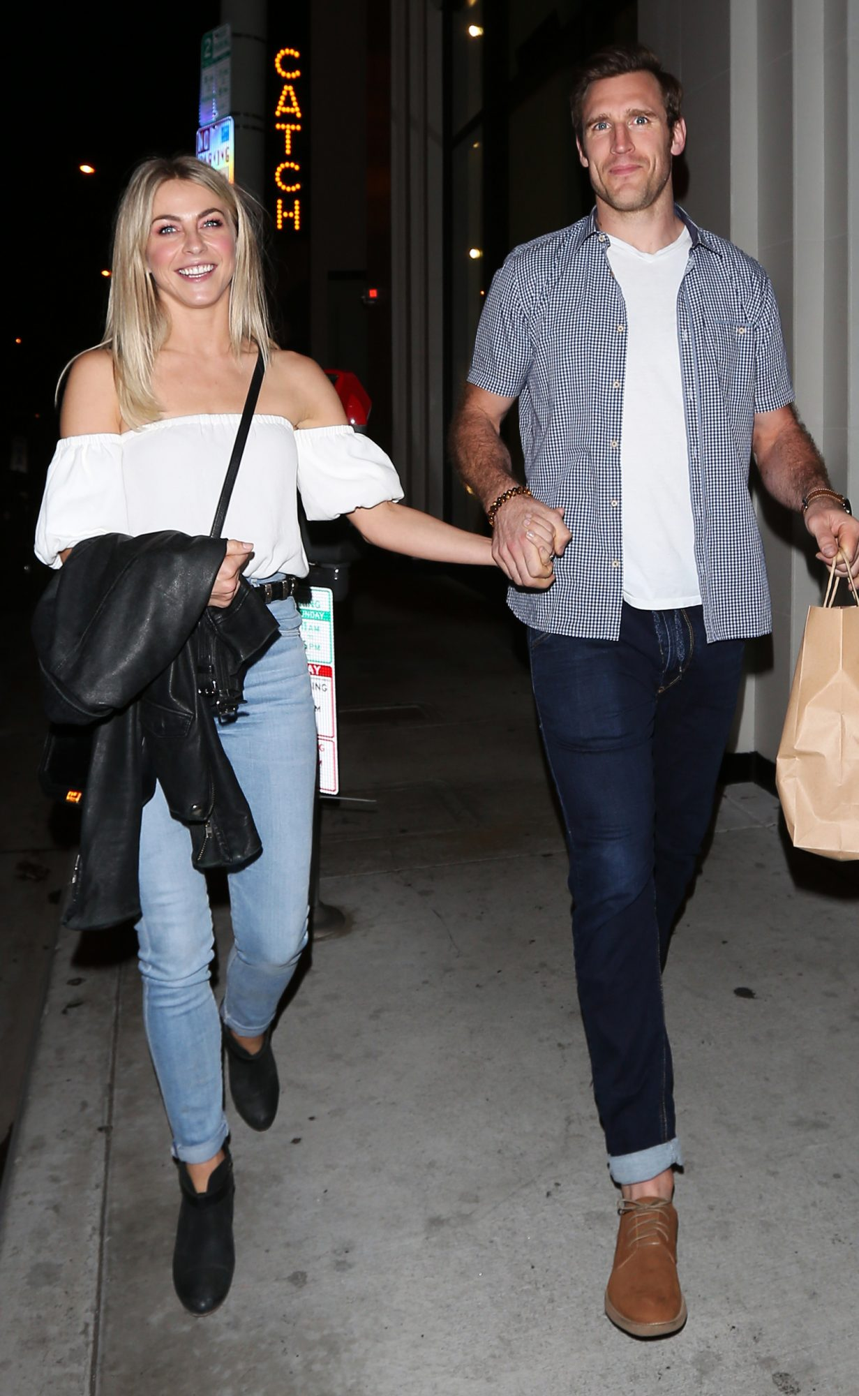 Julianne Hough and fiance Brooks Laich show some PDA as they leave Catch restaurant after having dinner