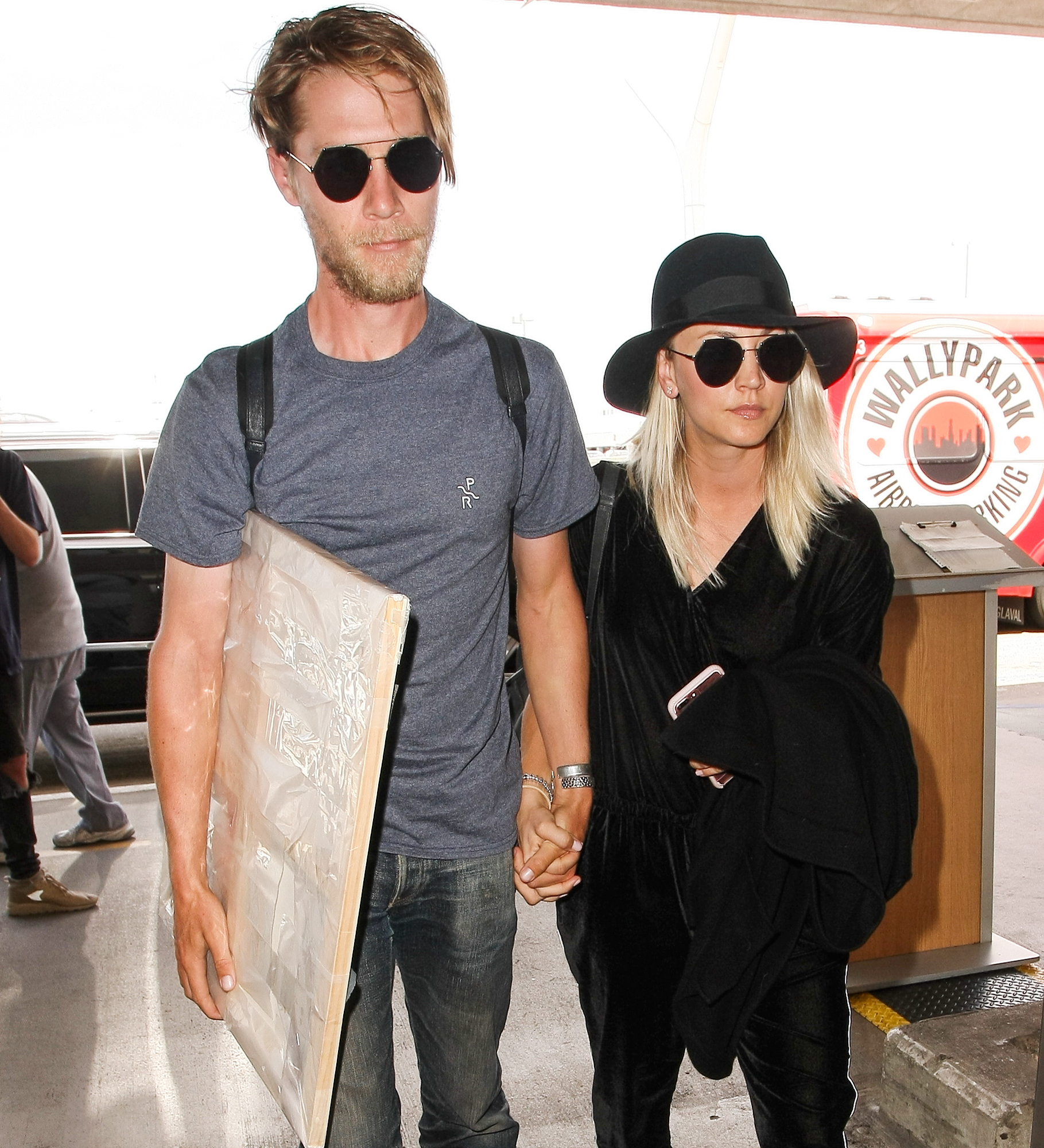 Kaley Cuoco and Karl Cook  jet out of LAX