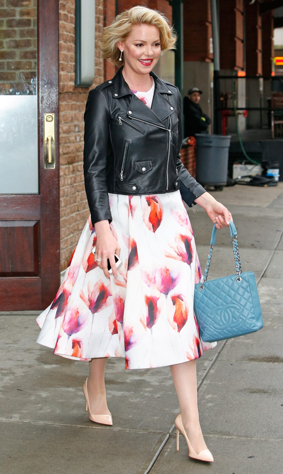 Katherine Heigl wears a leather biker jacket with a floral dress in New York City