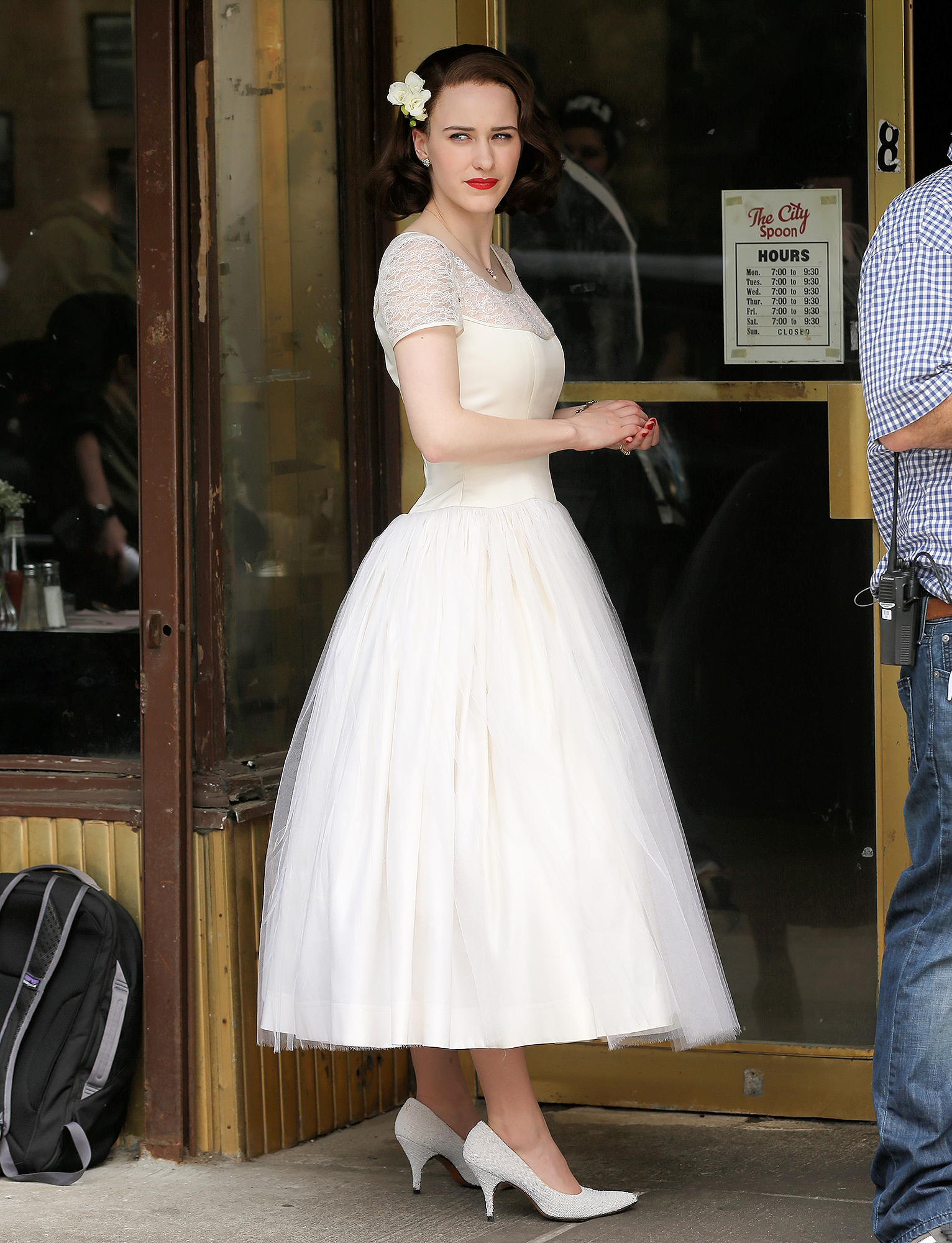 EXCLUSIVE: Actress Rachel Brosnahan, wearing a white evening dress, films 'The Marvelous Mrs. Maisel' in West Village in New York