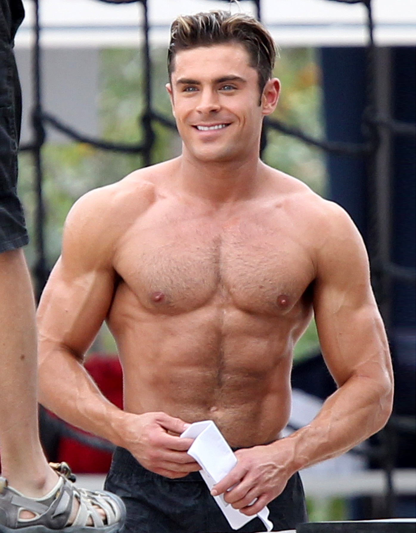 Zac Efron shirtless on the monkey bars filming Baywatch in Miami Beach