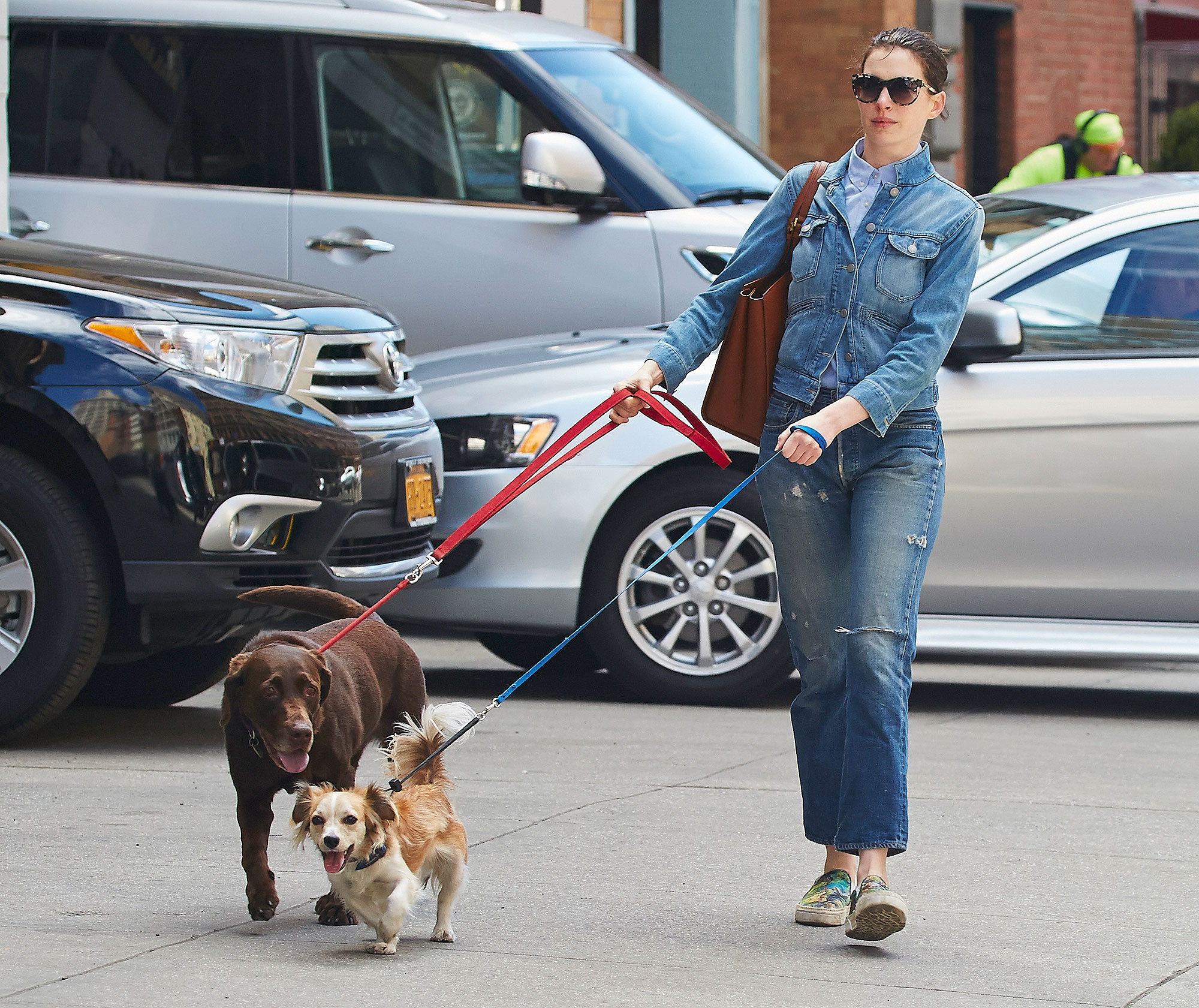 Anne Hathaway spotted wearing double denim while walking her two dogs Esmeralda and Edward in the East Village neighborhood of NYC