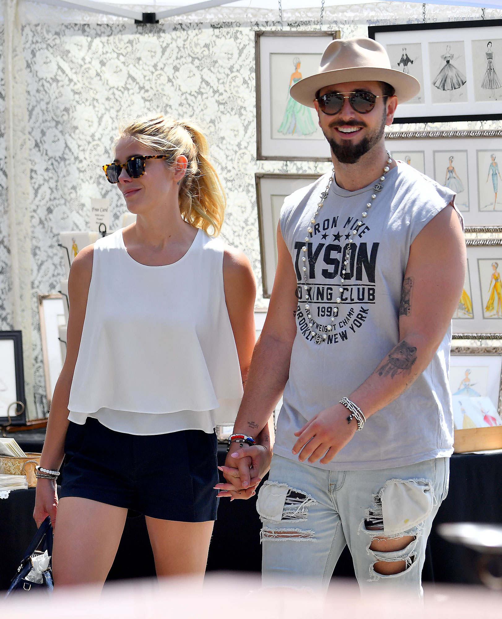 EXCLUSIVE: Ashley Greene and her Fiance Paul Khoury walk hand in hand as they shop at a local flea market in Los Angeles