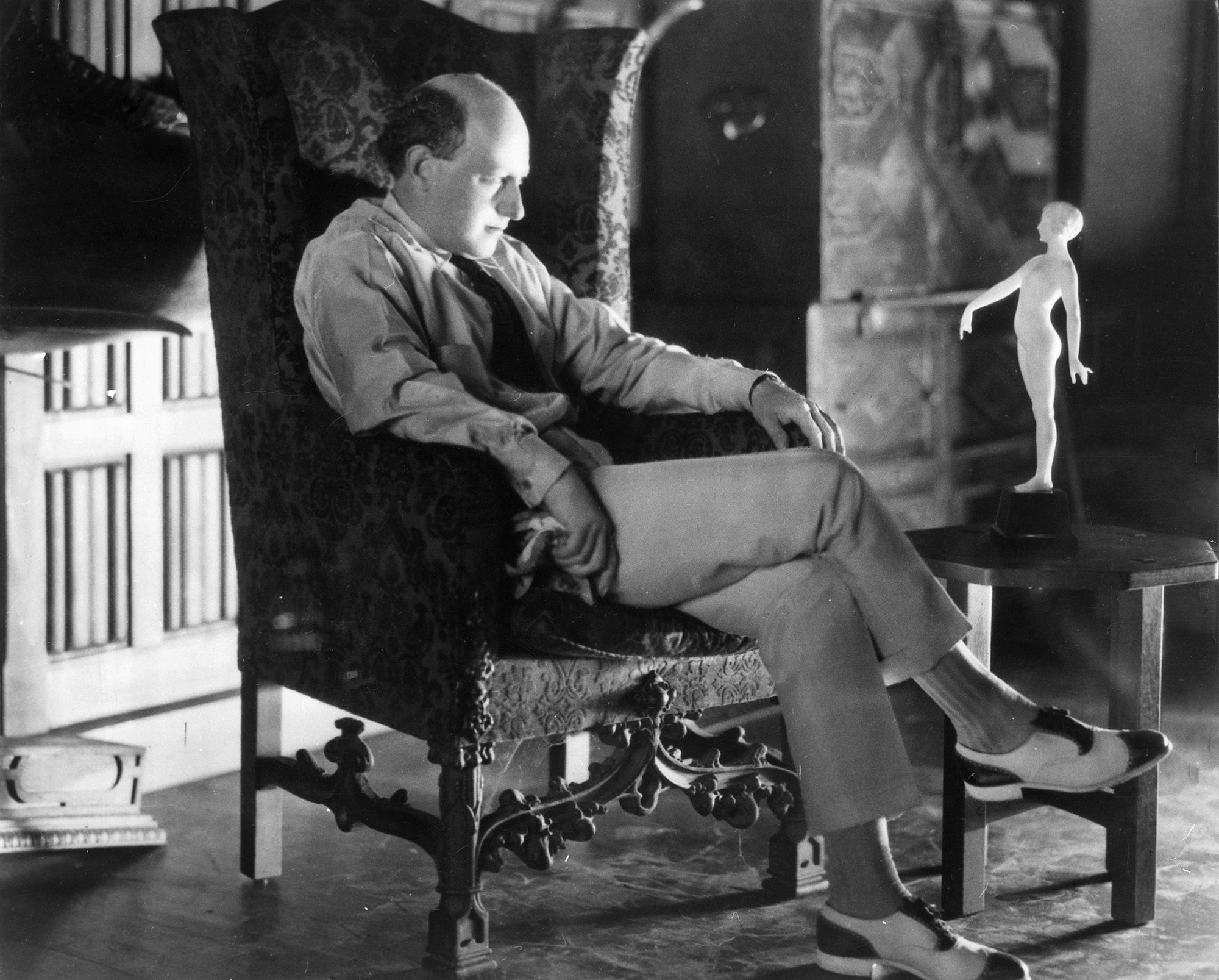 Cecil B. DeMille *12.08.1881-21.01.1959+ Film director, USA - portrait in an armchair in his house - 1928 - Photographer: James E. Abbe - Vintage property of ullstein bild