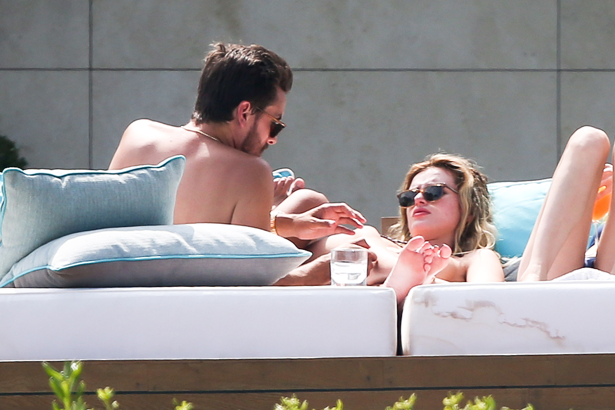 Scott Disick squeezes girlfriend Bella Thornes breast as they sunbathe in Cannes