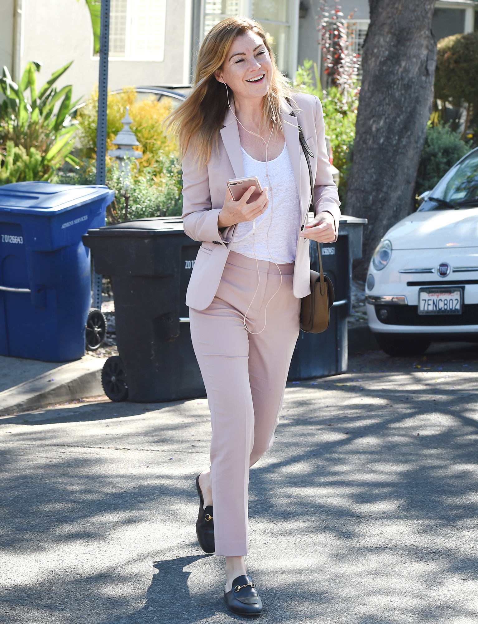 EXCLUSIVE: Ellen Pompeo wears a light pink business suit as she leaves a beauty salon while talking on her cellphone