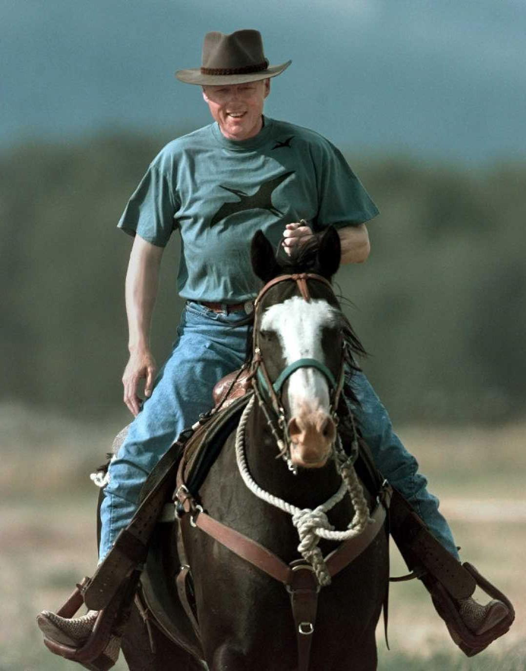 US President Bill Clinton rides a horse named Wink