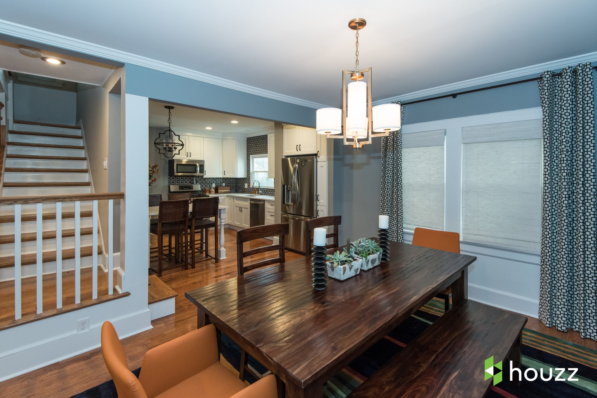 Opening up the walls between the living room, dining room, kitchen and stairwell created a more functional and beautiful space.