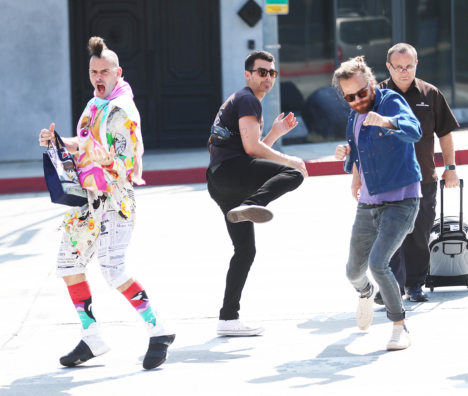 Joe Jonas and DNCE show off their karate moves while walking down Melrose Ave