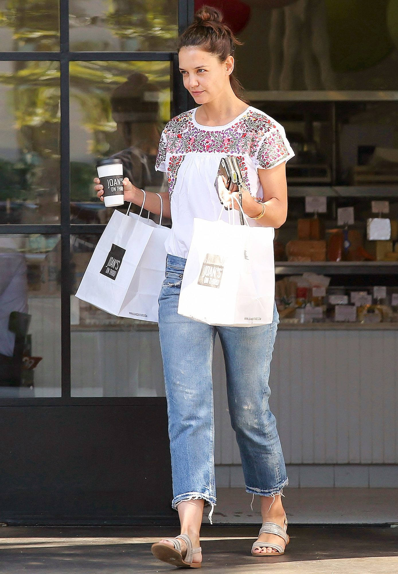 EXCLUSIVE: Katie Holmes has her hands full whilst leaving 'Joan's on Third' in Los Angeles, California