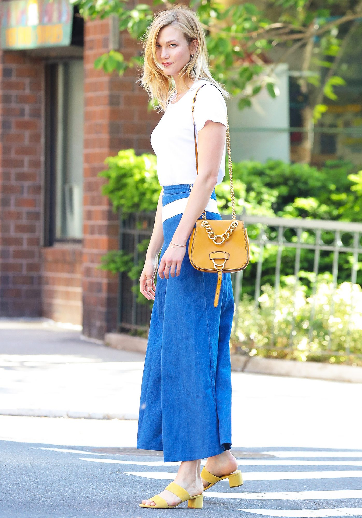 EXCLUSIVE: Karlie Kloss steps out wearing denim sailor pants and yellow accessories in New York City
