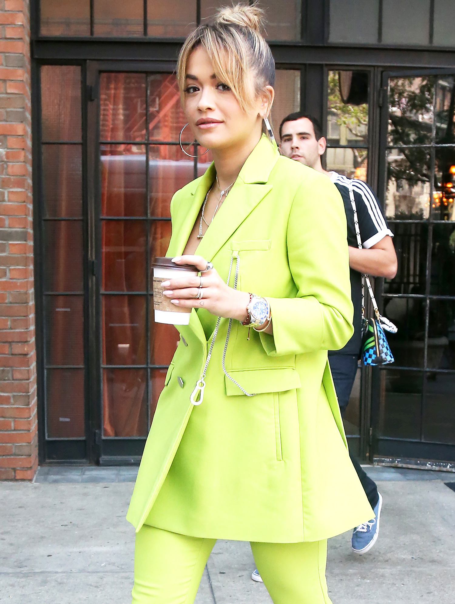 Rita Ora wears a fluorescent green suit outside her hotel in New York City