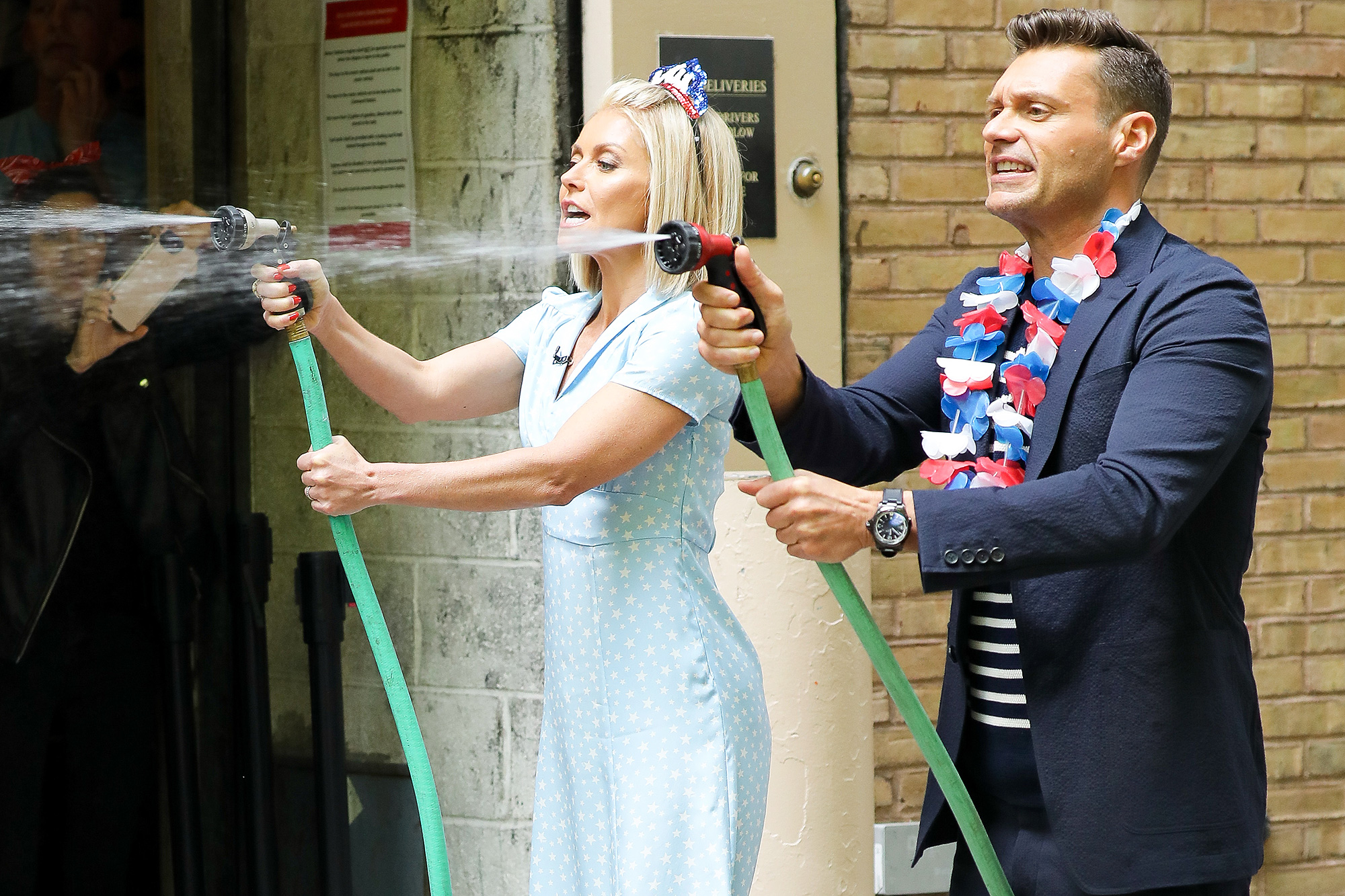 EXCLUSIVE: Kelly Ripa and Ryan Seacrest are spotted having fun with water hose in New York City