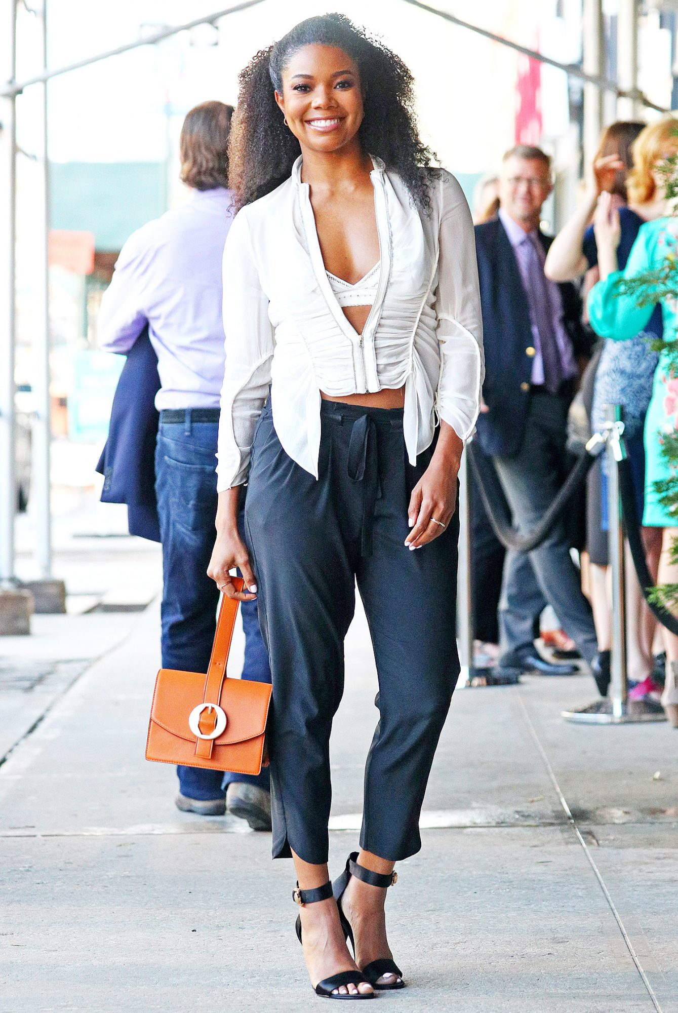 EXCLUSIVE: Actress Gabrielle Union steps out wearing a gathered white top and black pants in New York City, New York