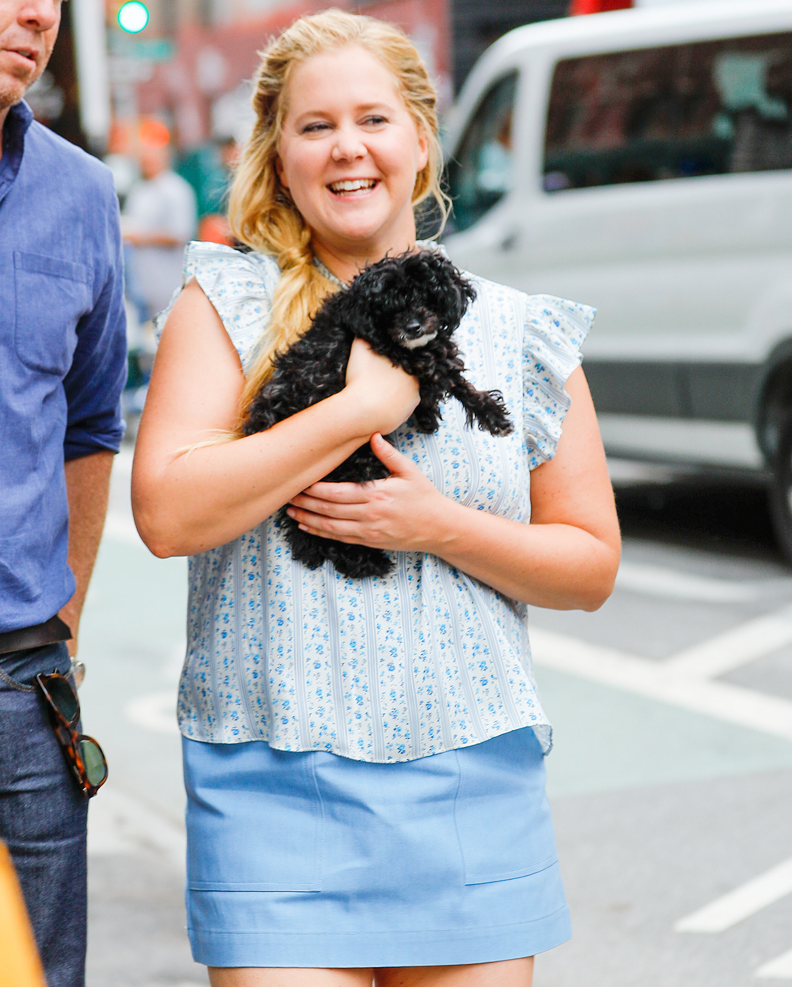 Amy Schumer carries her dog while out and about in New York