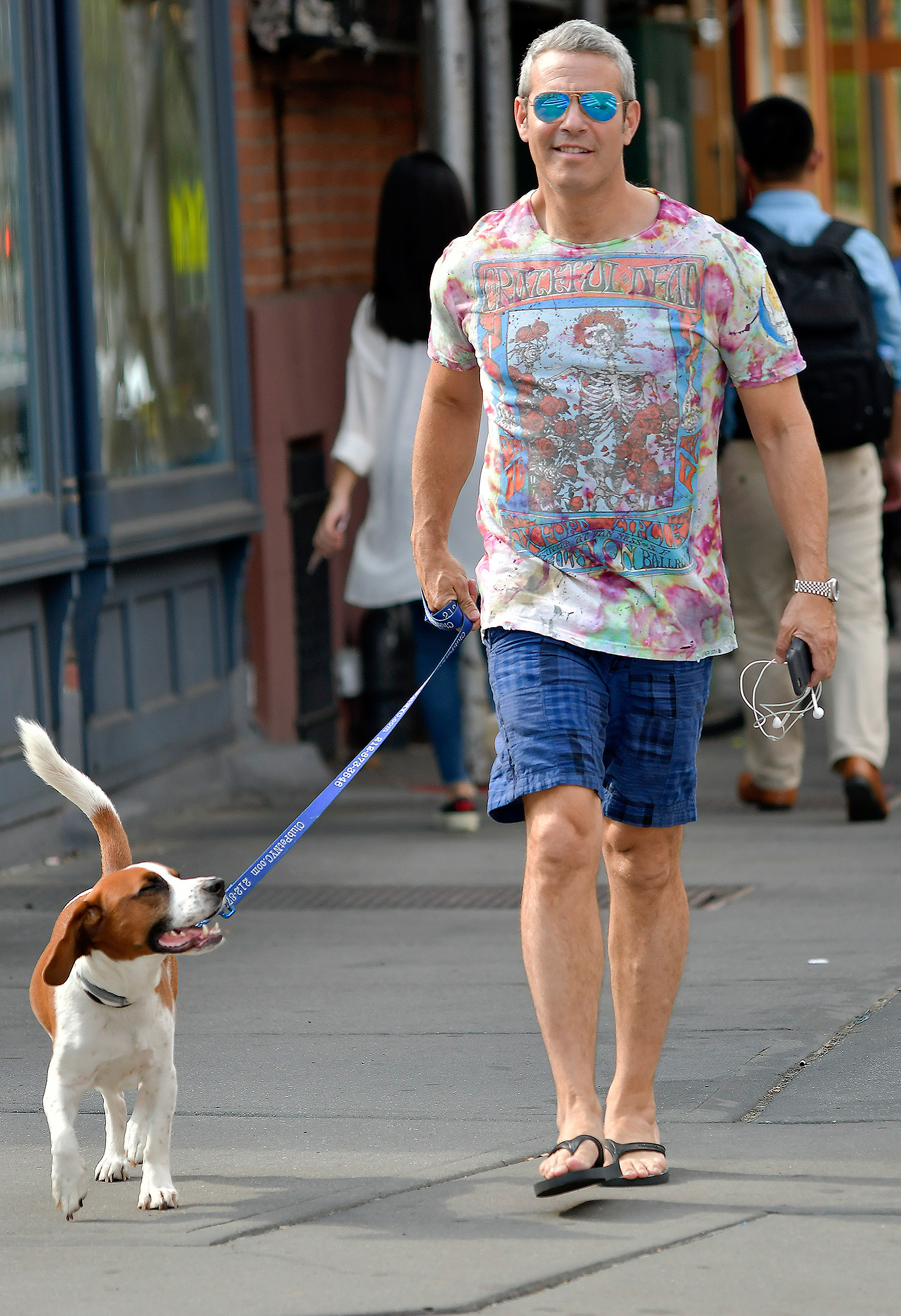 EXCLUSIVE: Andy Cohen wears a Grateful Dead shirt while walking his dog in the West Village in New York City