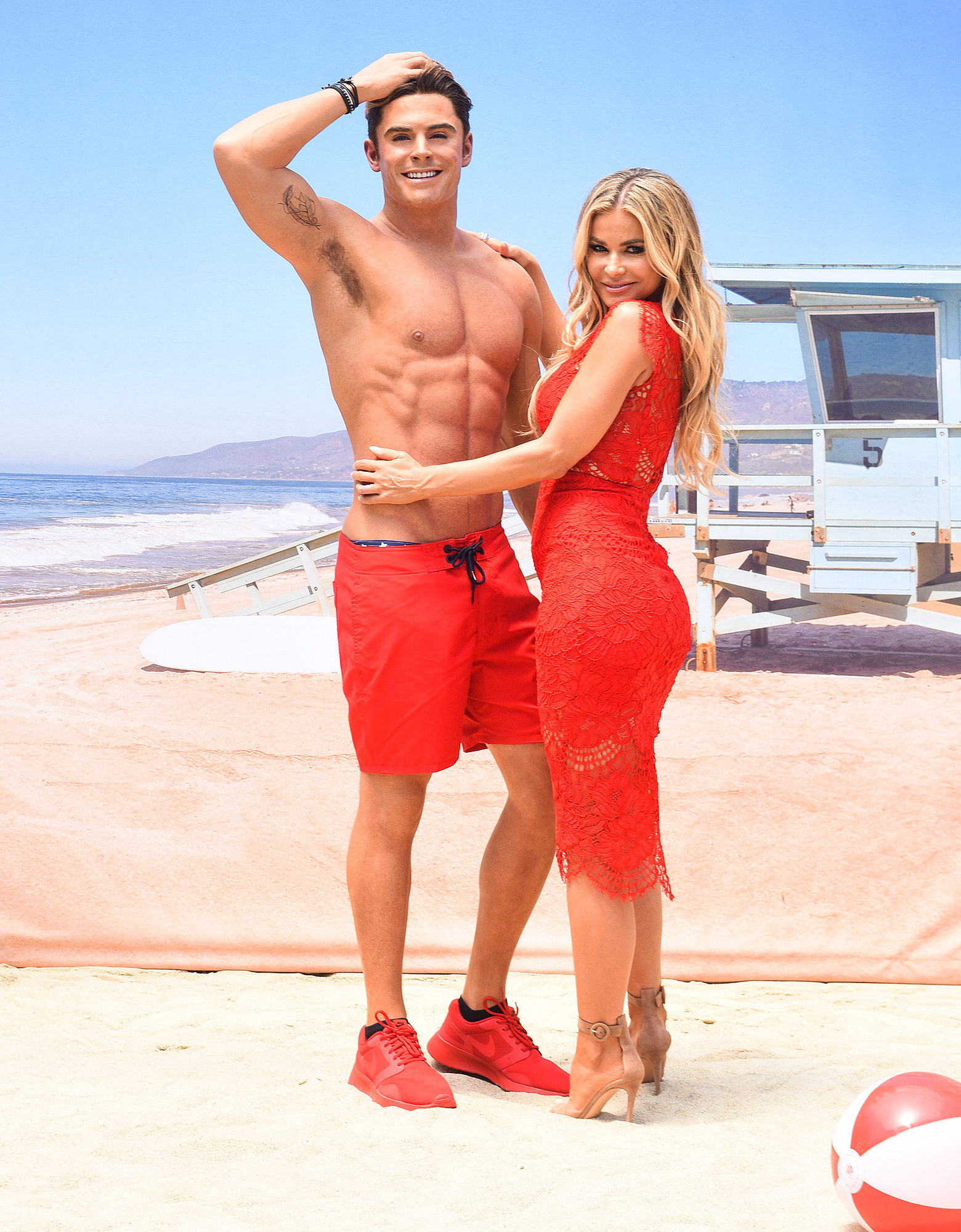 """Madame Tussauds Hollywood unveils new Zac Efron """"Baywatch"""" wax figure with Carmen Electra and the men from Australia's Thunder from Down Under"""