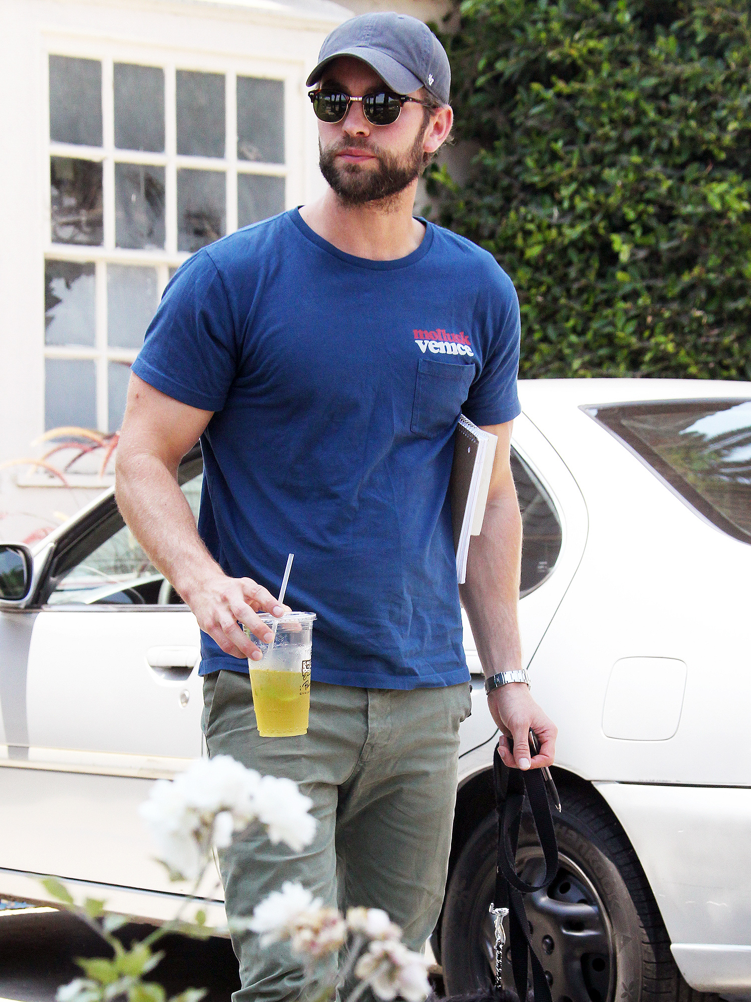 EXCLUSIVE: Chace Crawford spotted with his dog having an iced tea in L.A.