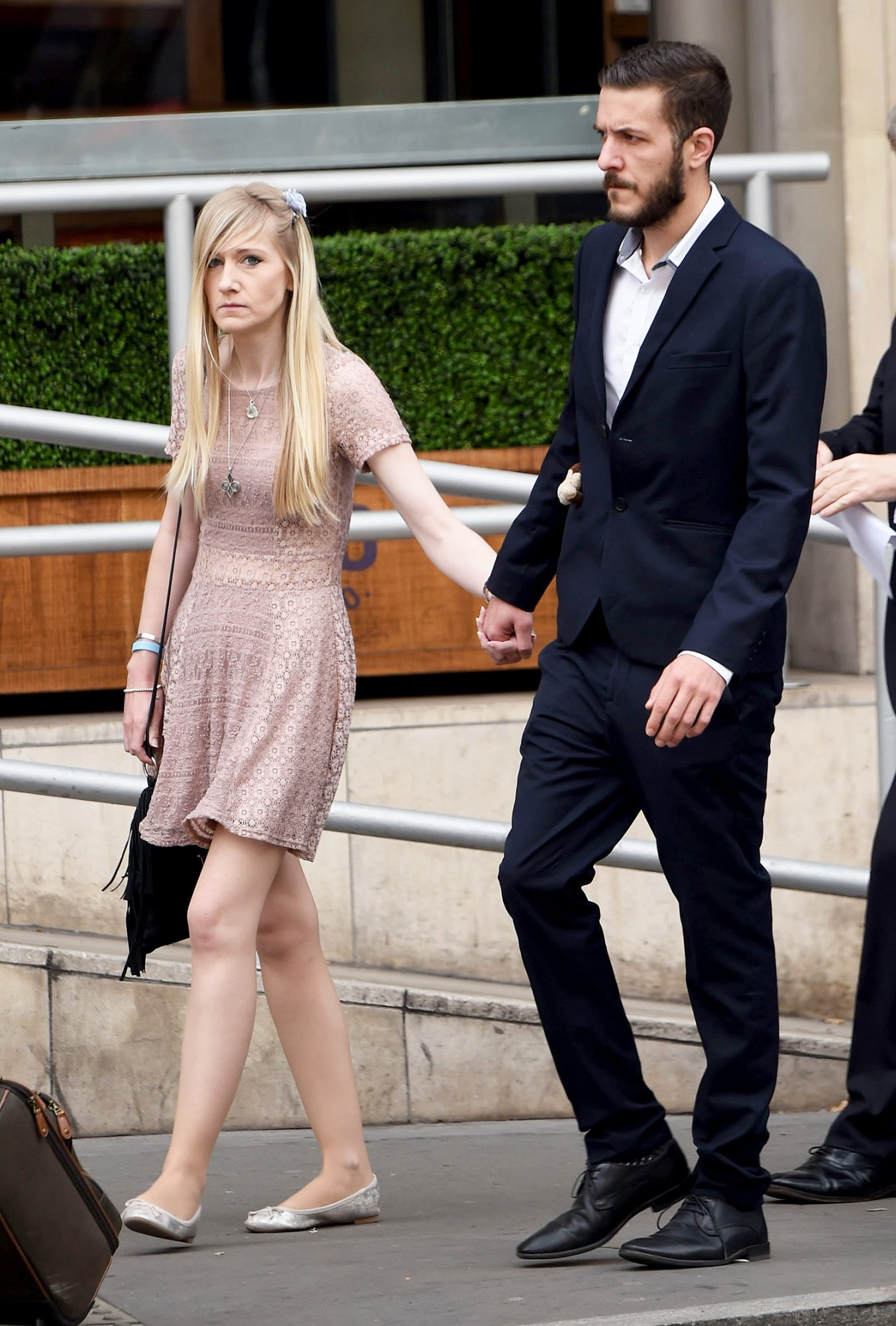 Chris Gard and Connie Yates arrive at the High Court this morning for the latest judgement on their son Charlie