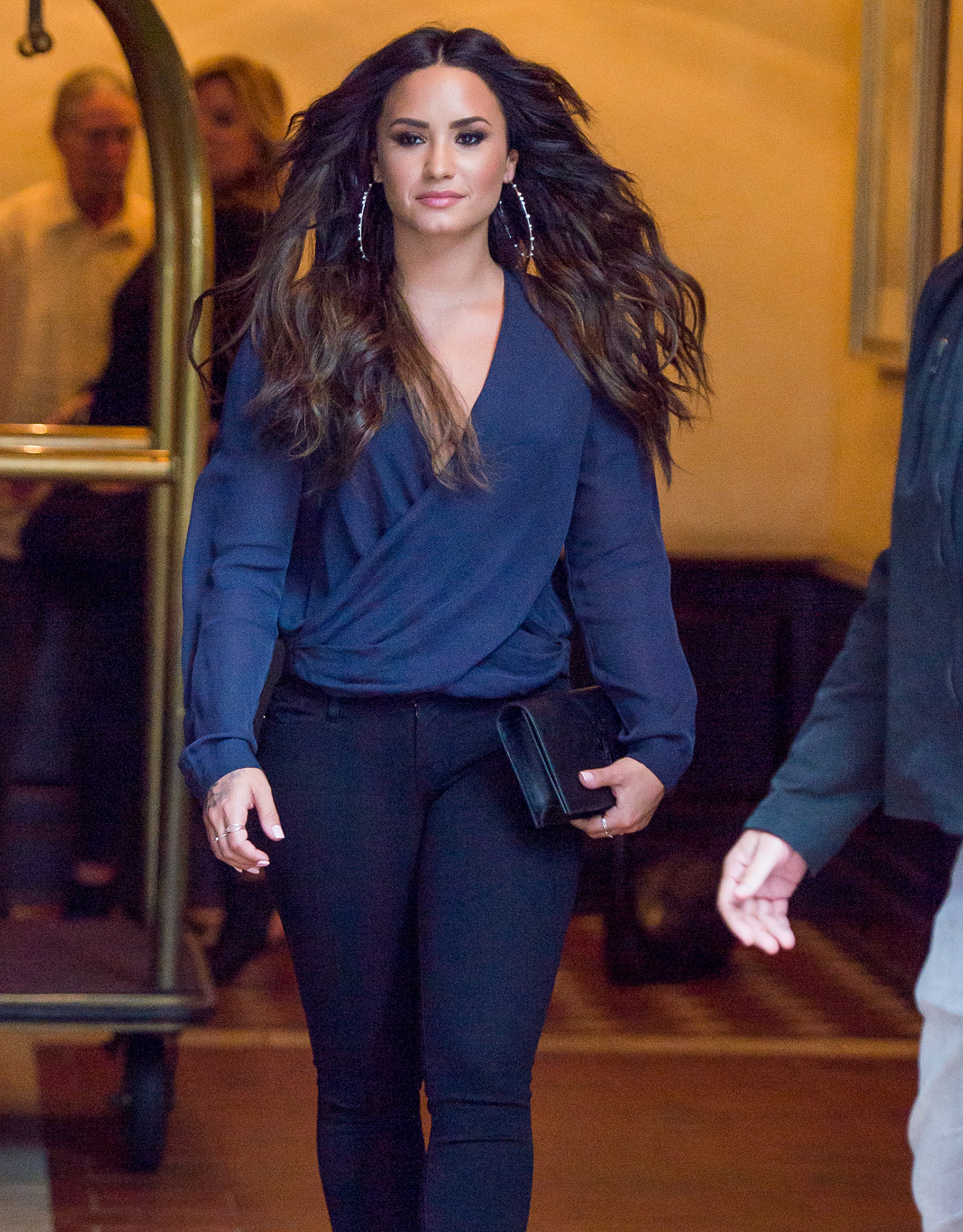 EXCLUSIVE: Demi Lovato seen wearing black & blue heading to the Kendrick Lamar concert in New York City