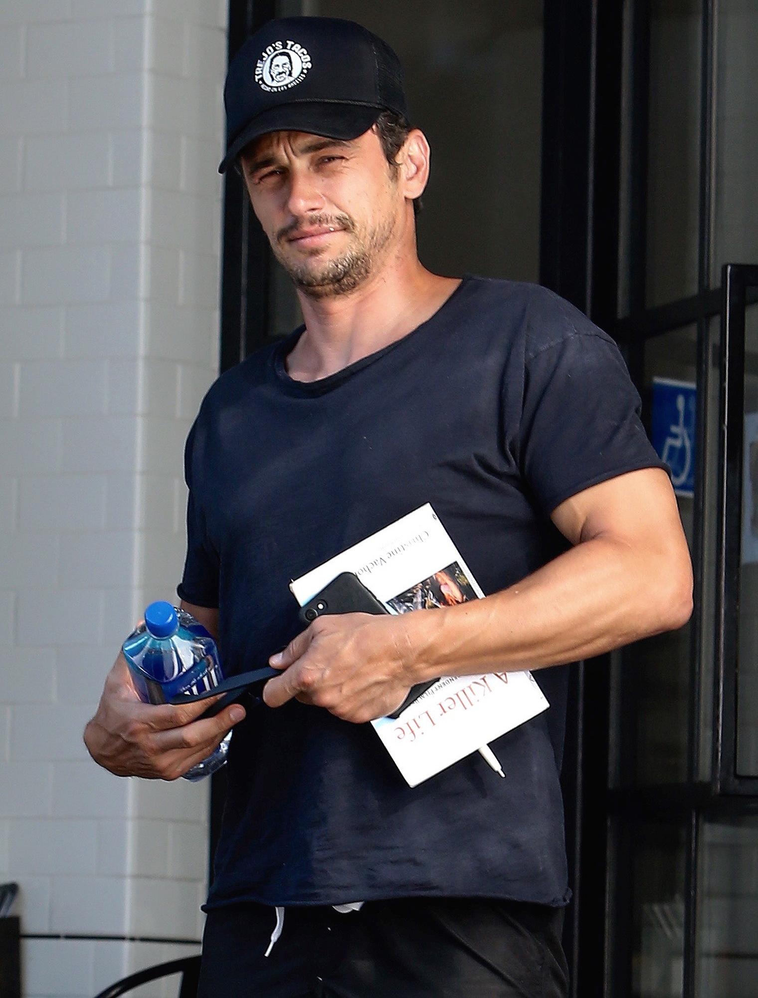 EXCLUSIVE: Actor James Franco is seen carrying the book 'A Killer Life' while out and about in Los Angeles