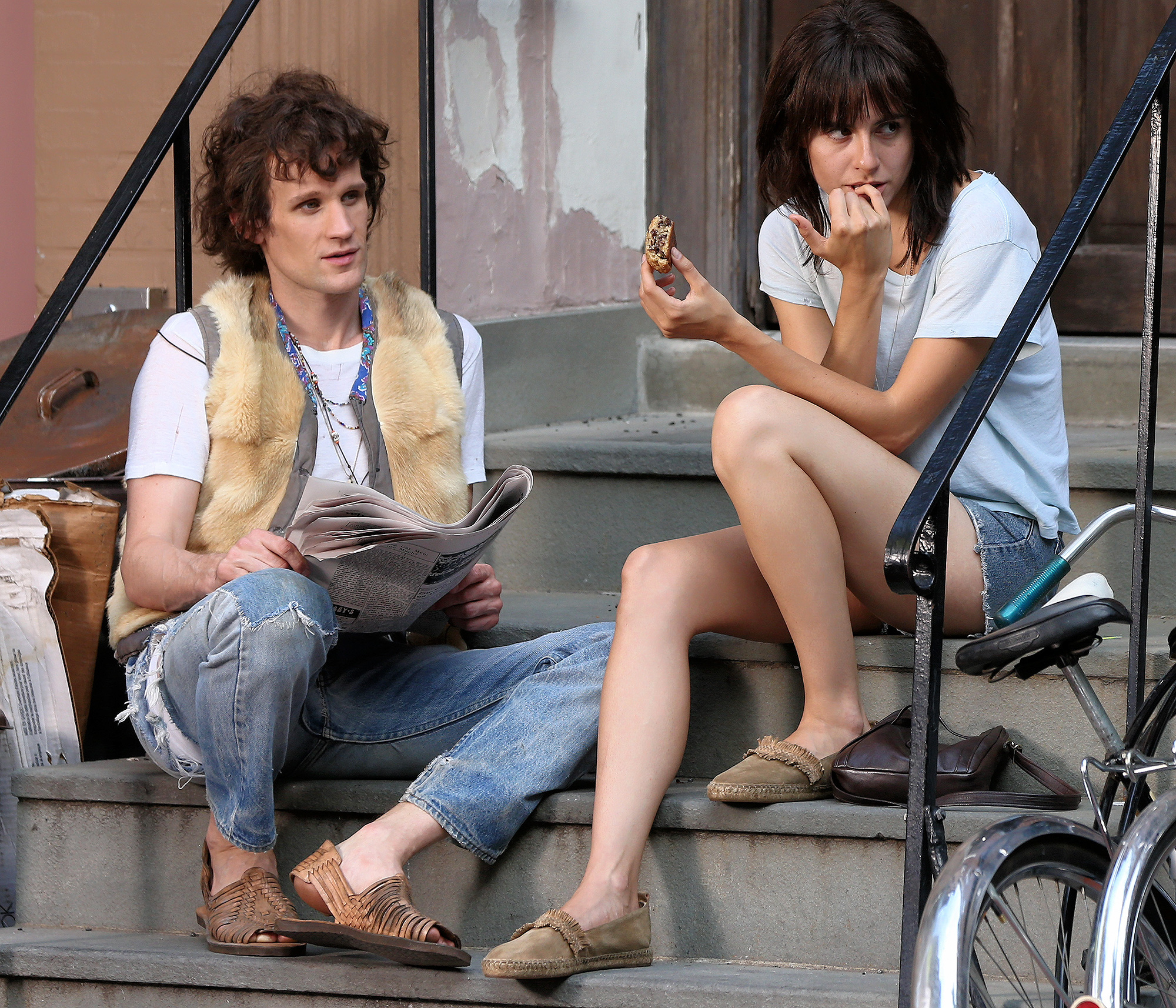 EXCLUSIVE: Actor Matt Smith and Marianne Rendon, playing Robert Mapplethorpe and Patti Smith respectively, film 'Mapplethorpe' directed by Ondi Timoner on a stoop in Greenwich Village in New York City.