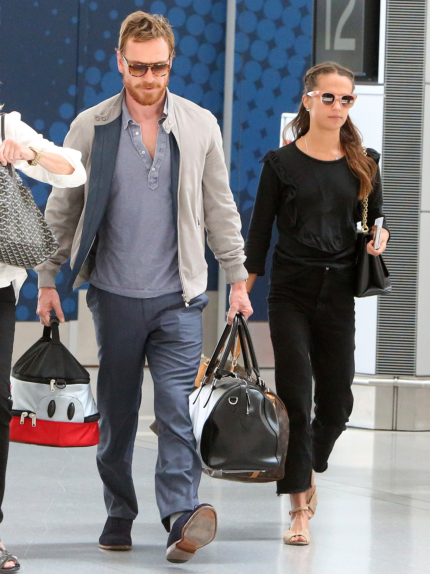 EXCLUSIVE: Michael Fassbender and Alicia Vikander spotted flying out of Toronto Airport