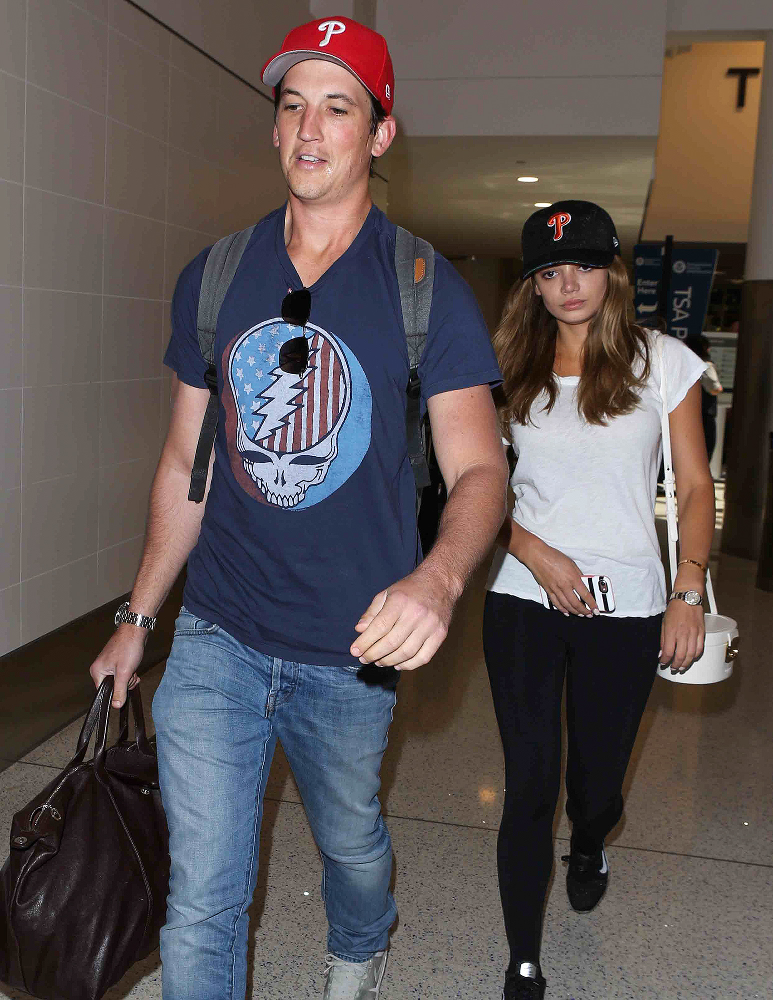 Miles Teller and his girlfriend arrive at LAX Airport in Los Angeles, Ca