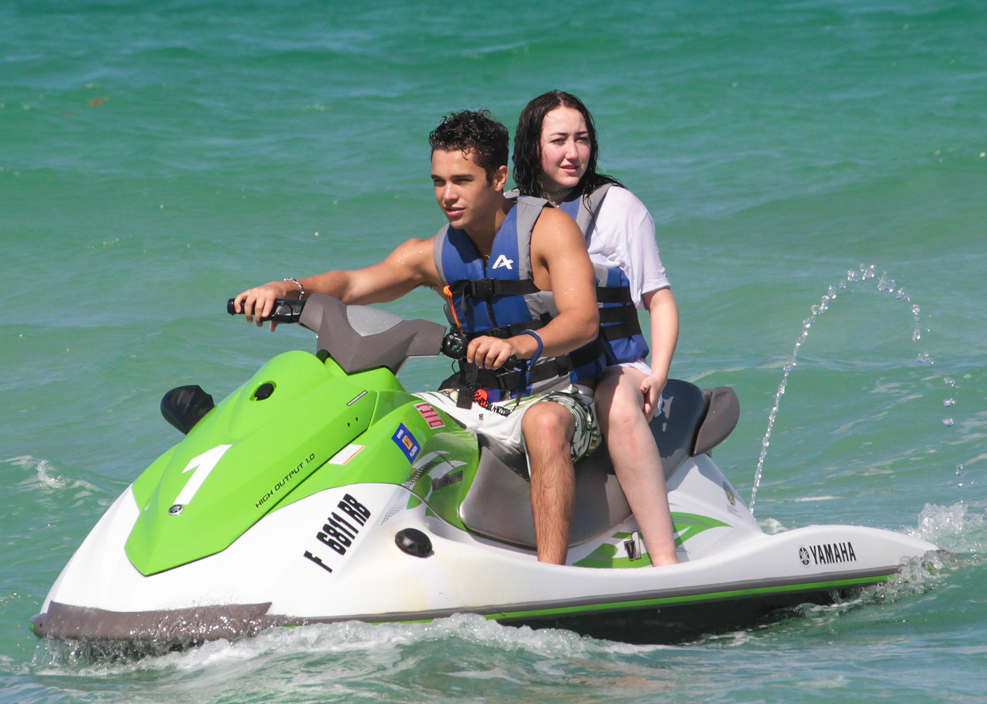 Singers Austin Mahone and Noah Cyrus riding  the waves on a Jet ski in Miami Beach