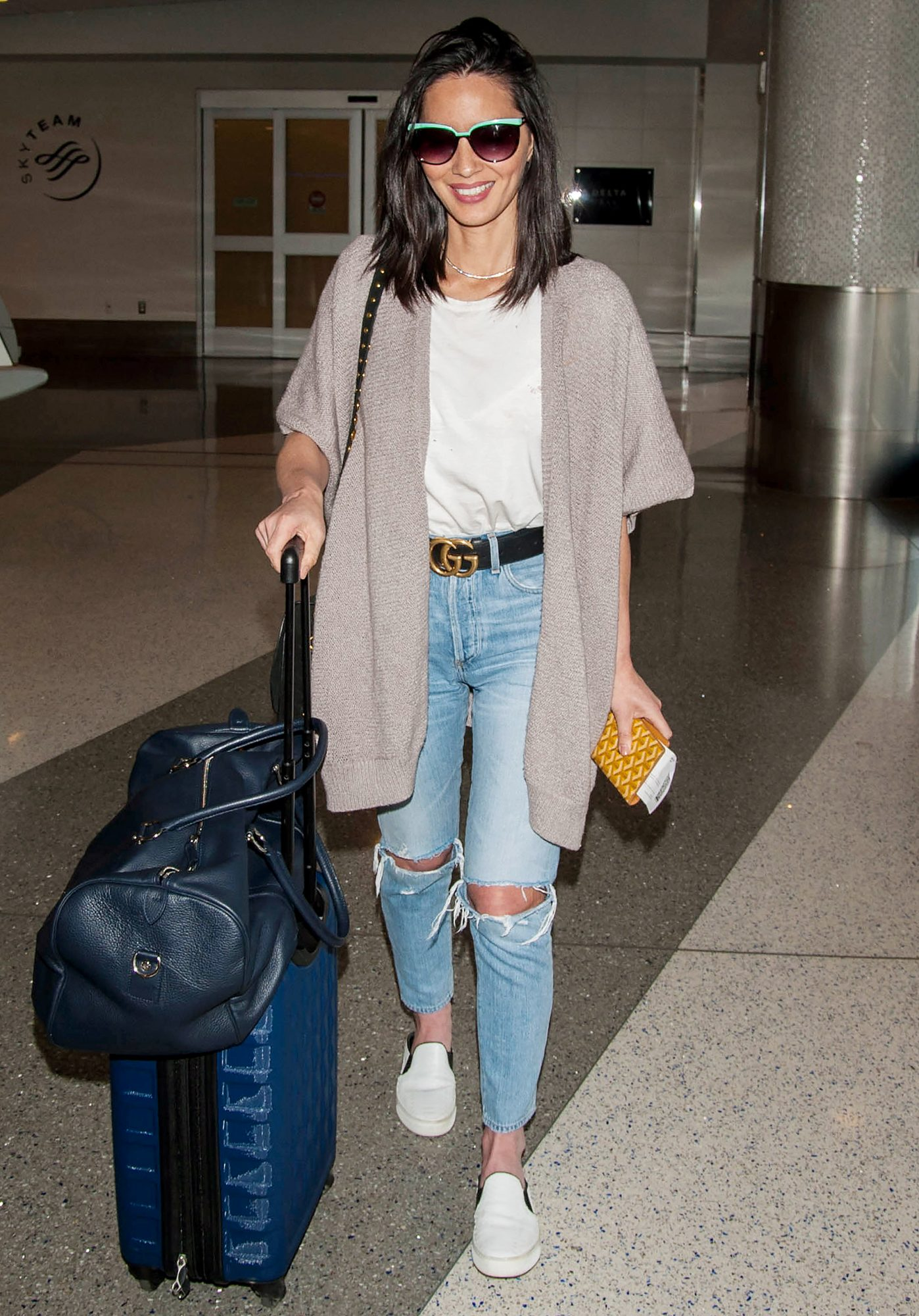Olivia Munn is all smiles at LAX airport in Los Angeles post breakup with NFL quarterback Aaron Rodgers