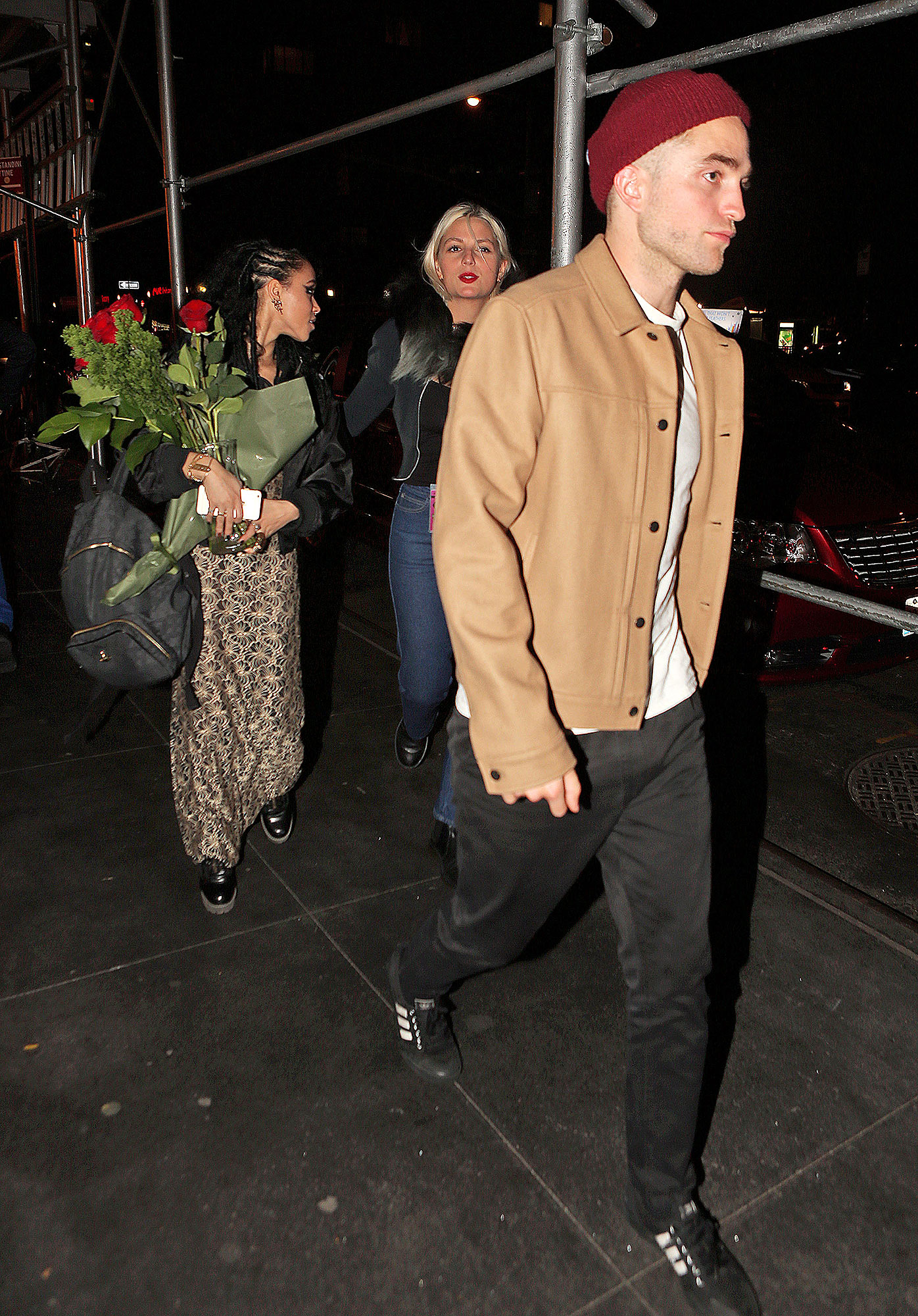 EXCLUSIVE: FKA Twigs is given a dozen beautiful roses from boyfriend Robert Pattinson after her first sold out NYC concert as they make their way to the afterparty