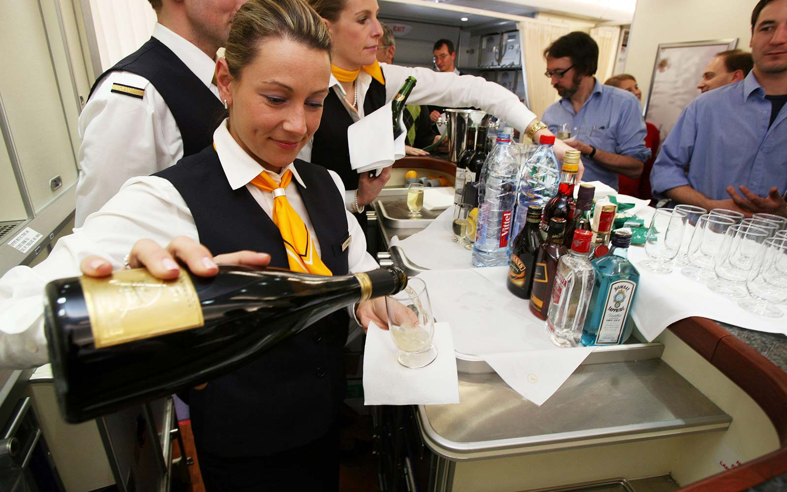 A flight attendant serves champagne on an Airbus A380 airpla