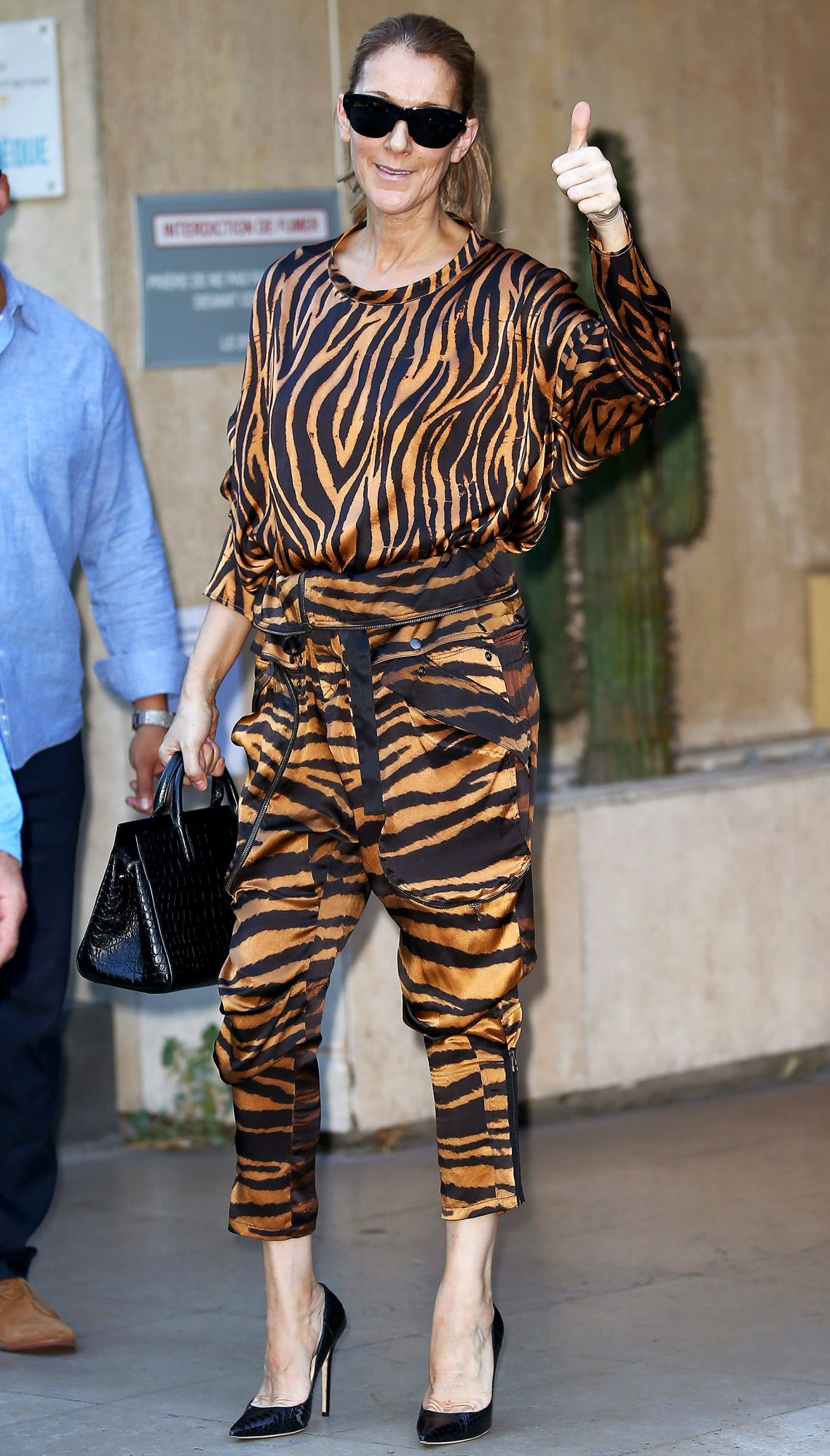 Celine Dion leaves her Hotel for the Kenclub sport center in tiger clothes