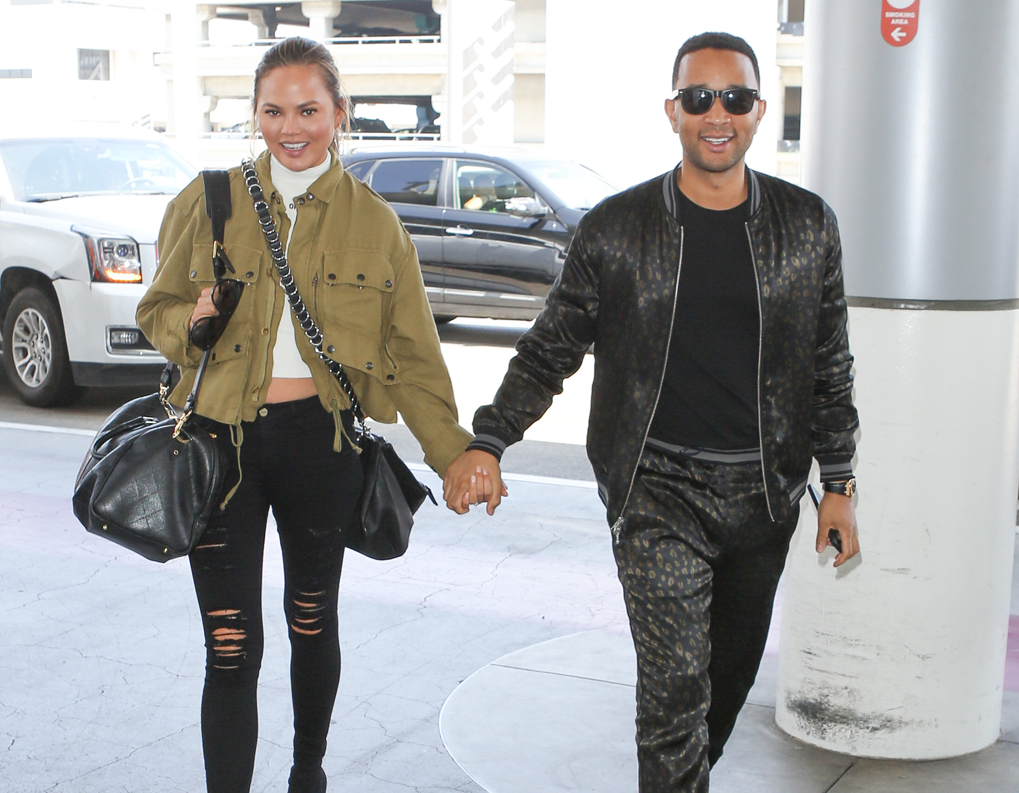 john Legend and Chrissy Tiegen are spotted at Los Angeles International Airport