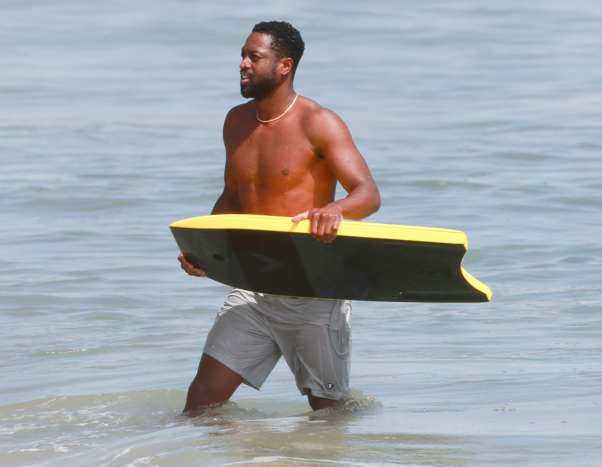 EXCLUSIVE: Chicago Bulls guard Dwyane Wade hits the waves with a friend in Malibu