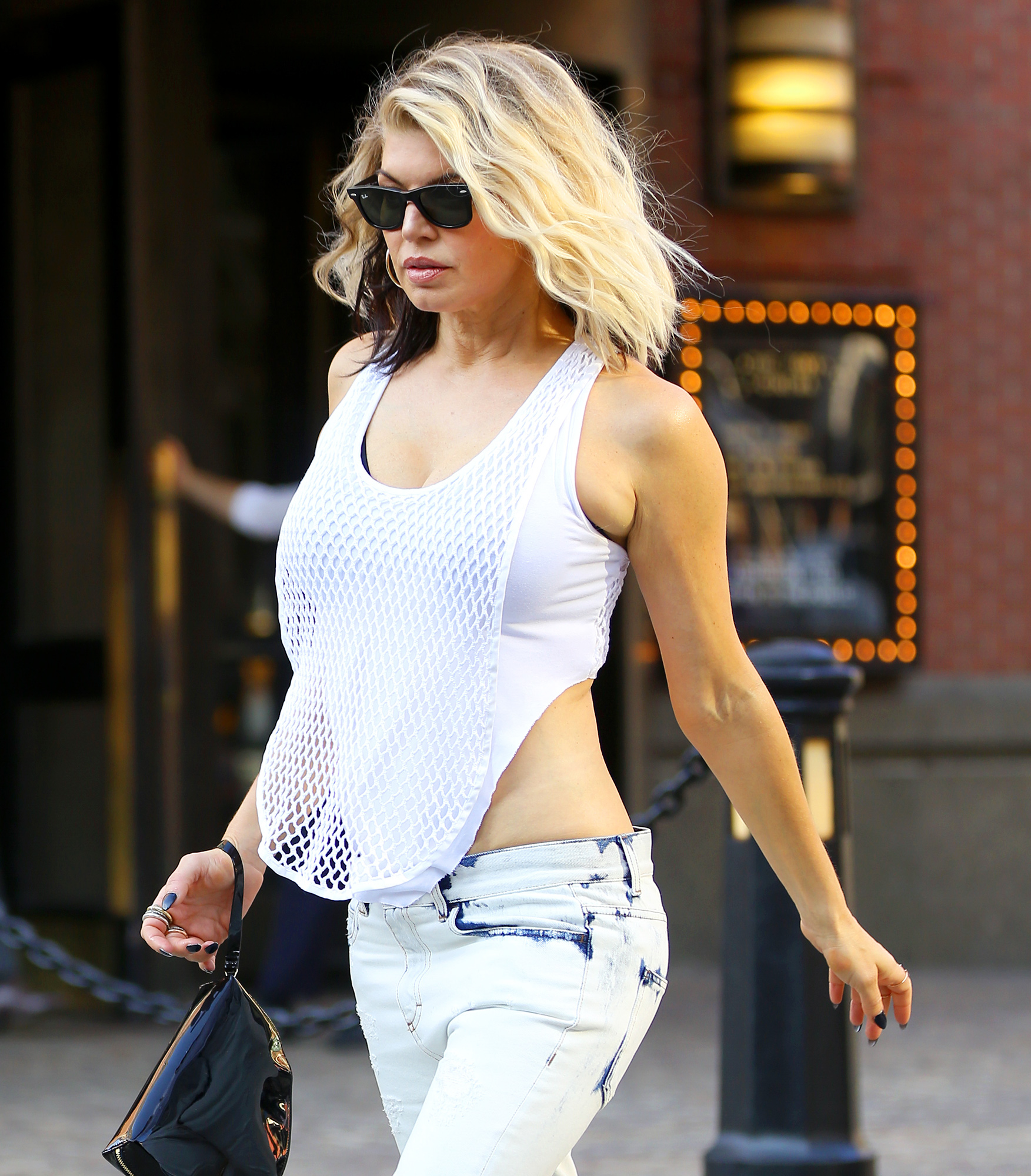 EXCLUSIVE: Fergie steps out in white fashion while showing off her bling in New York City