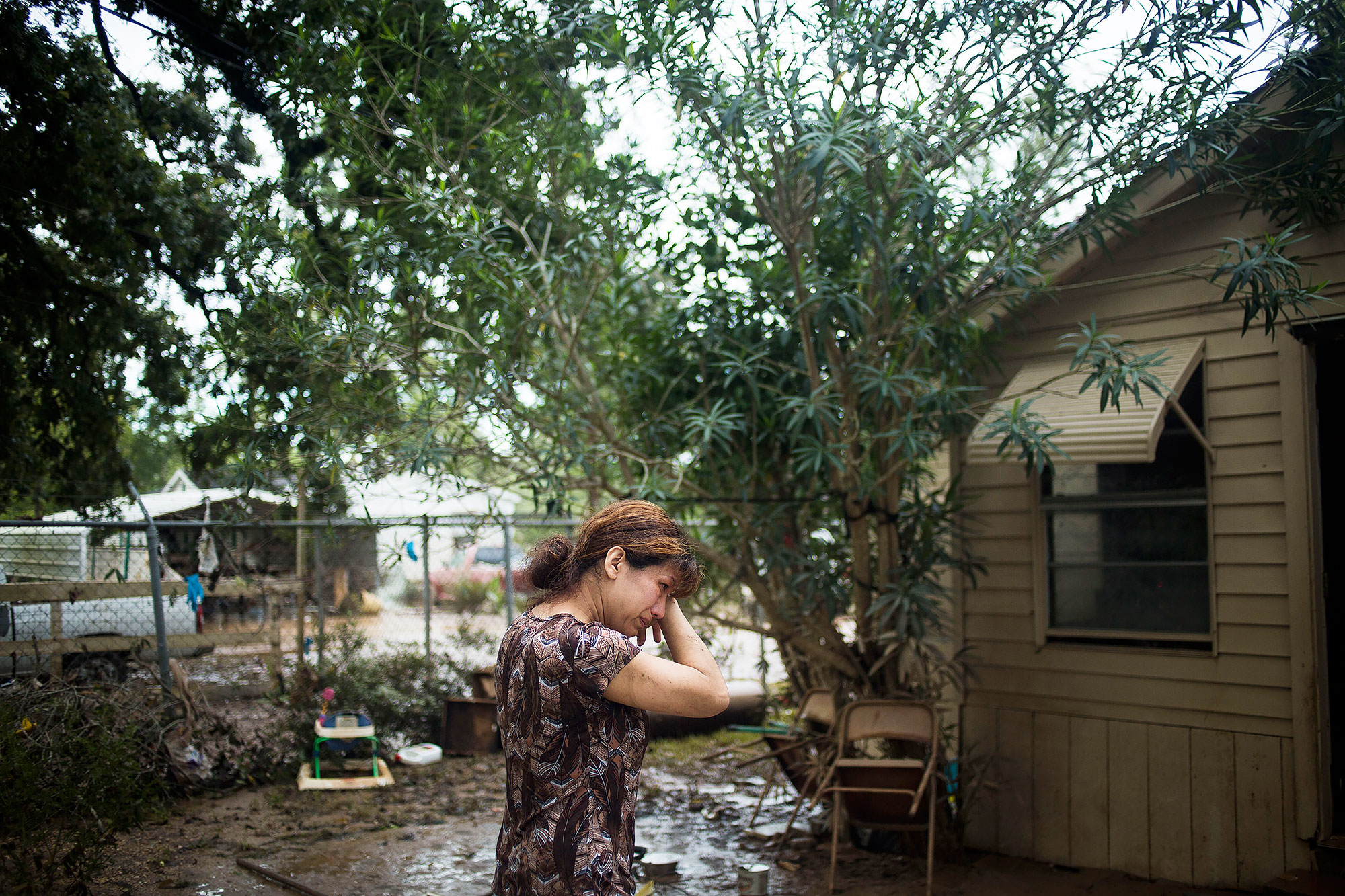 Flor Portilla outside her home in East Houston, Texas after Hur