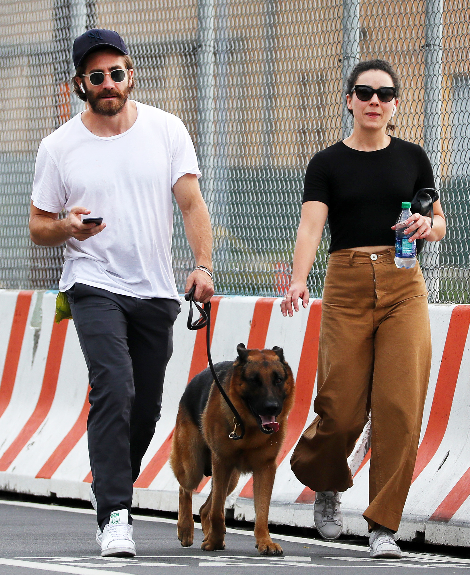 EXCLUSIVE: Jake Gyllenhaal and Friend, Greta Caruso Wear Matching Adidas Trainers as they Walk Jakes's Beloved Pooch, Atticus.