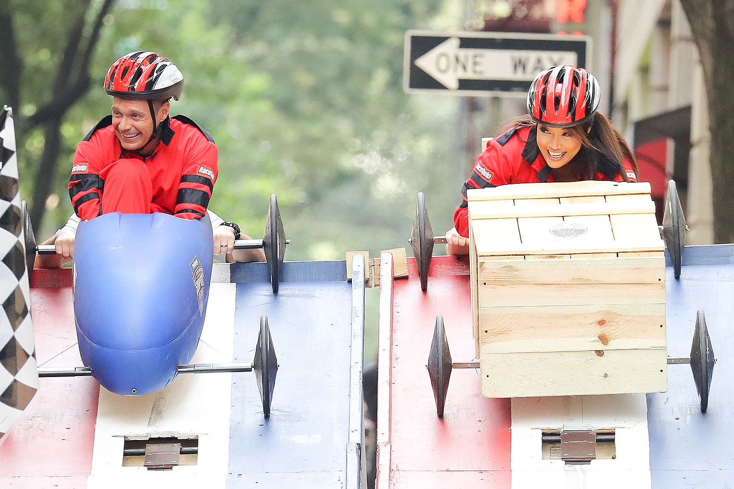 EXCLUSIVE: Ryan Seacrest and Carrie Ann Inaba are seen doing a box car race outside the 'Live with Kelly and Ryan' studios in New York City