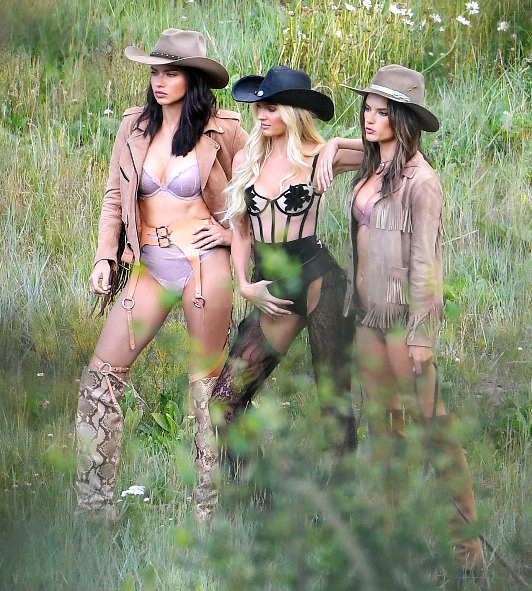 EXCLUSIVE: Supermodels Alessandra Ambrosio, Adriana Lima, & Candice Swanepoel wear sexy cowboy outfits while shooting for Victoria Secret's upcoming holiday catalog in Aspen, CO.