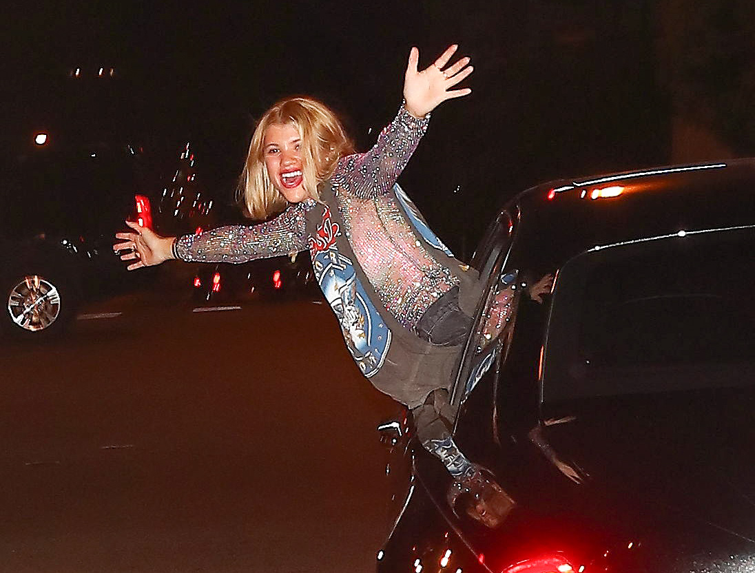 Sofia Richie is so happy she sticks her head out of her car window in Los Angeles
