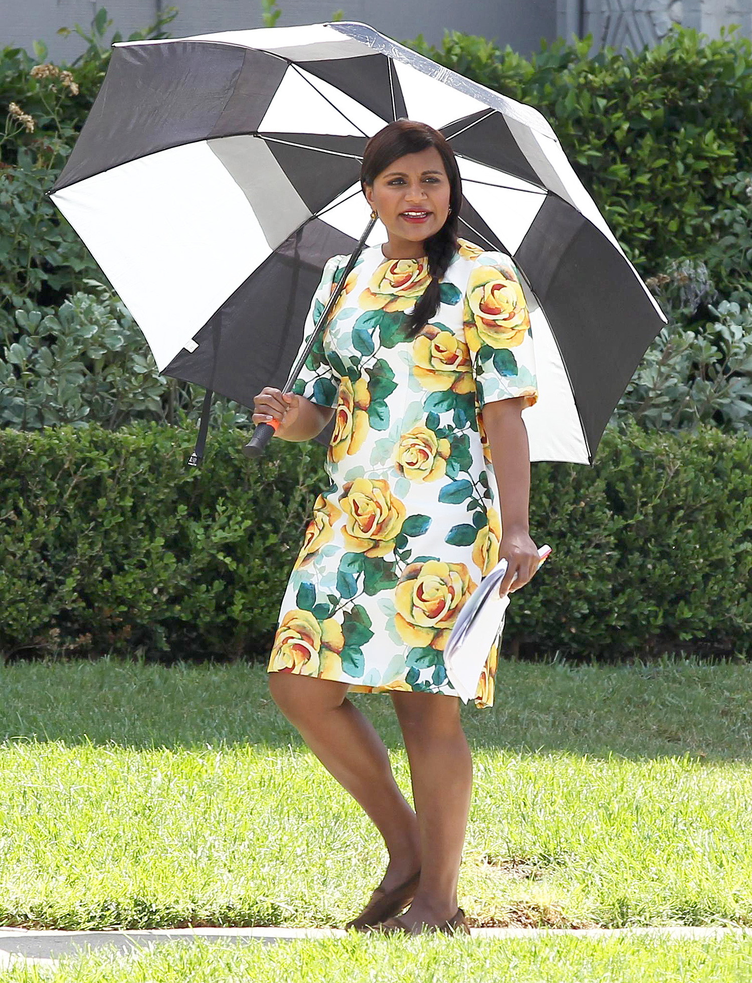 Mindy Kaling wears a yellow floral dress on the set of The Mindy Project in Los Angeles