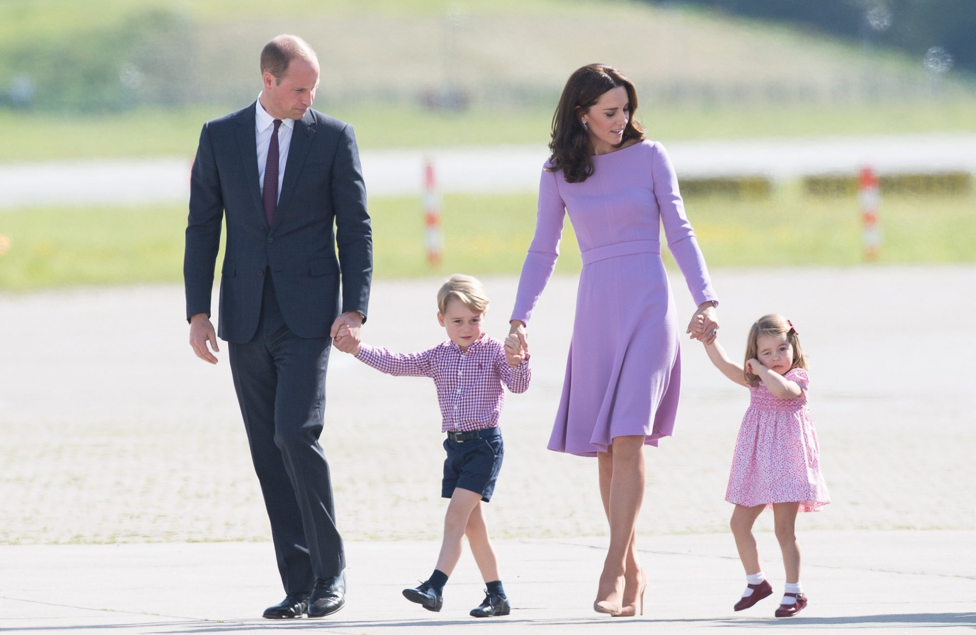 HAMBURG, GERMANY - JULY 21: Prince William, Duke of Cambridge, Prince George, Princess Charlotte of Cambridge and Catherine, Duchess of Cambridge view helicopter models H145 and H135 before departing from Hamburg airport on the last day of their official visit to Poland and Germany on July 21, 2017 in Hamburg, Germany. (Photo by Samir Hussein/WireImage)
