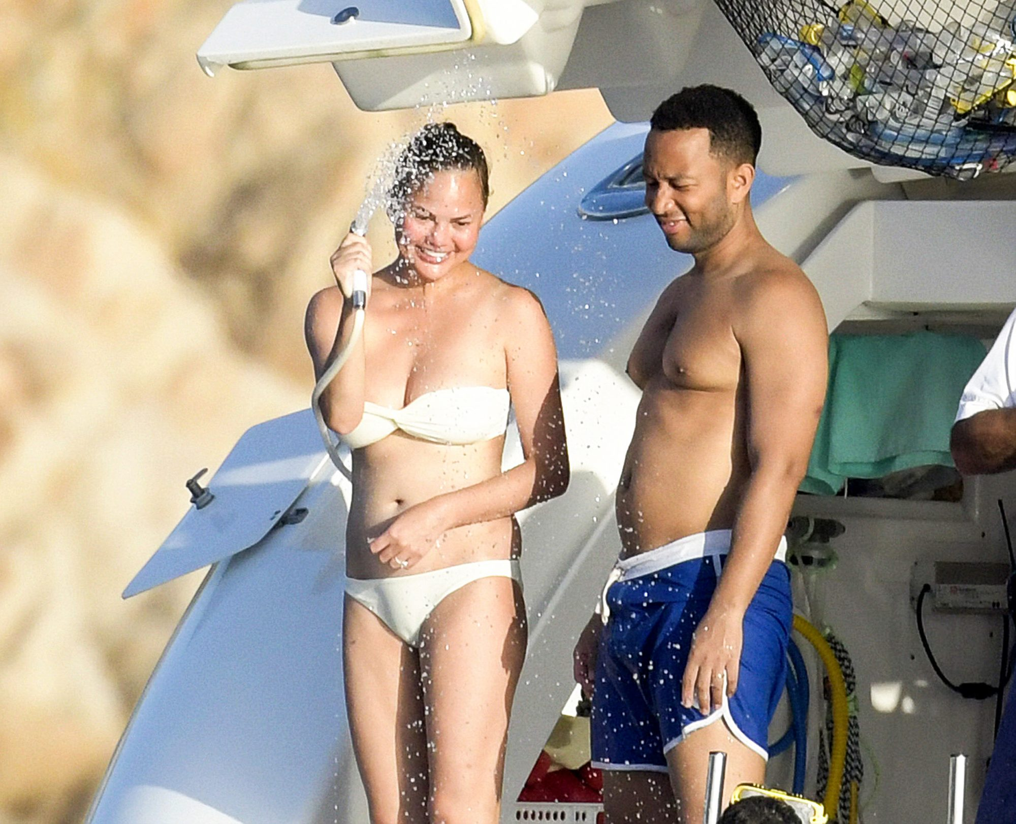 John Legend and Chrissy Teigen enjoy a spot of paddle boarding while on vacation in Sardinia