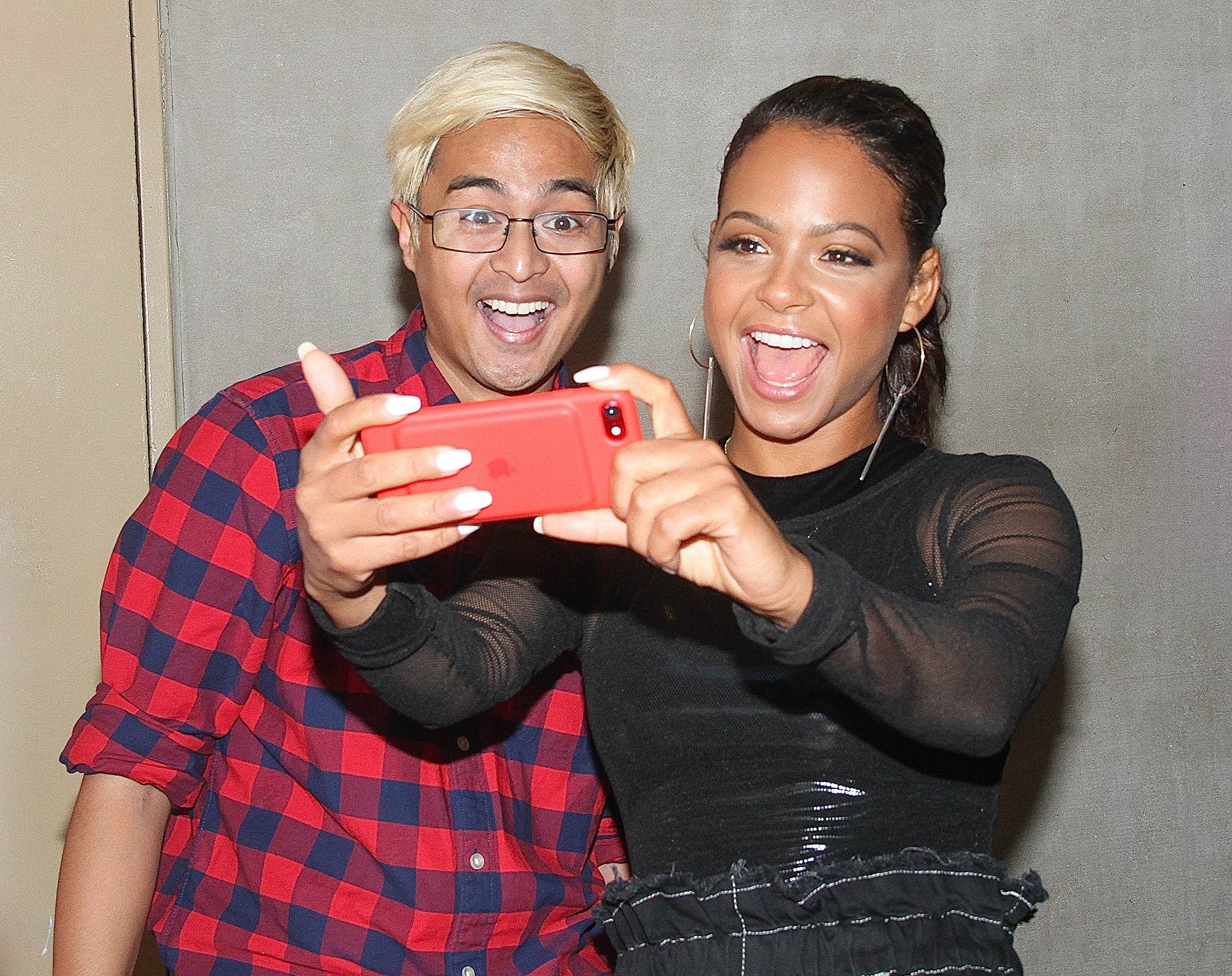 Actress, singer and media personality Christina Milian spotted taking a fun selfie with a fan at the 'Today' show in NYC's Rockefeller Center