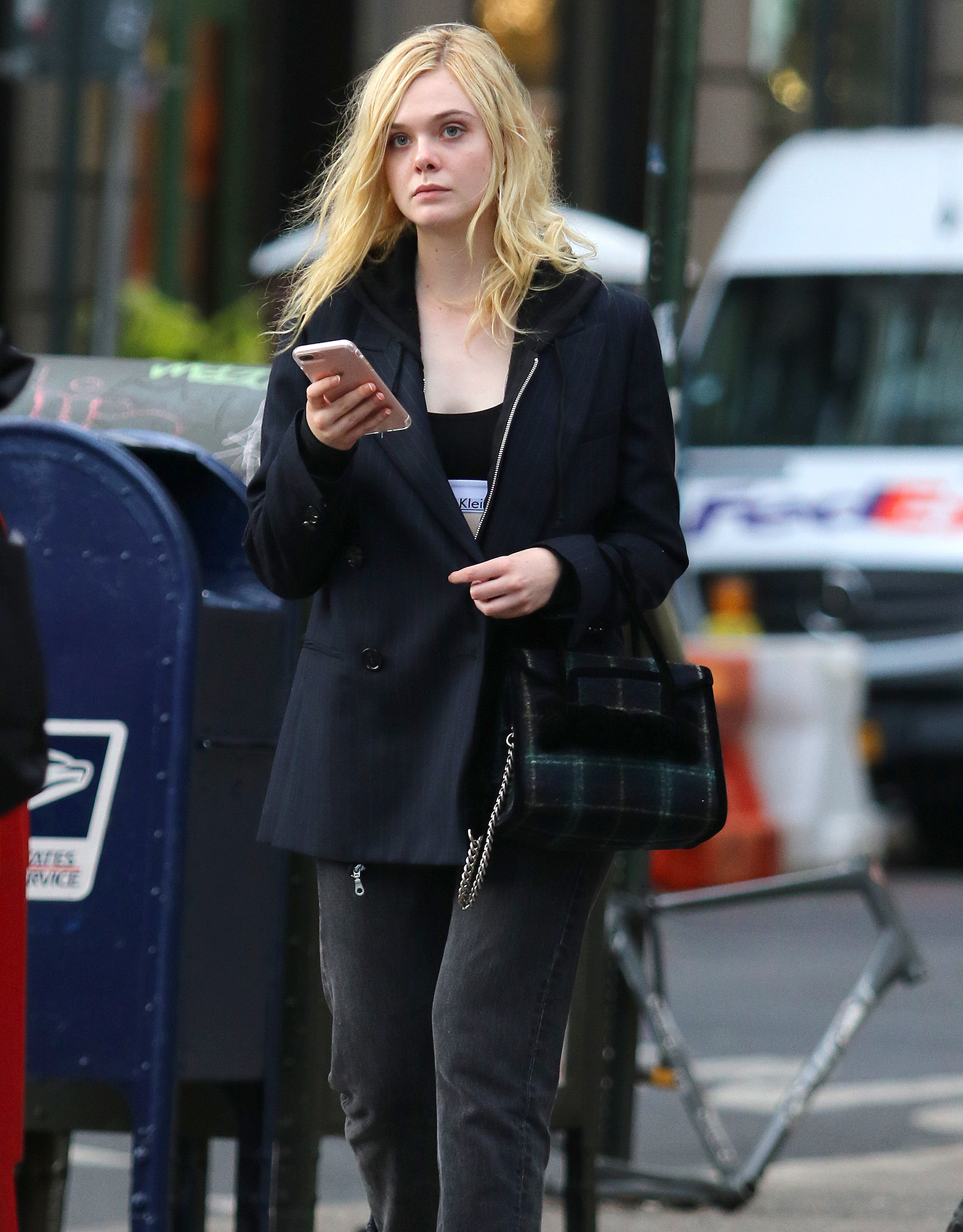 Elle Fanning busy texting in NYC