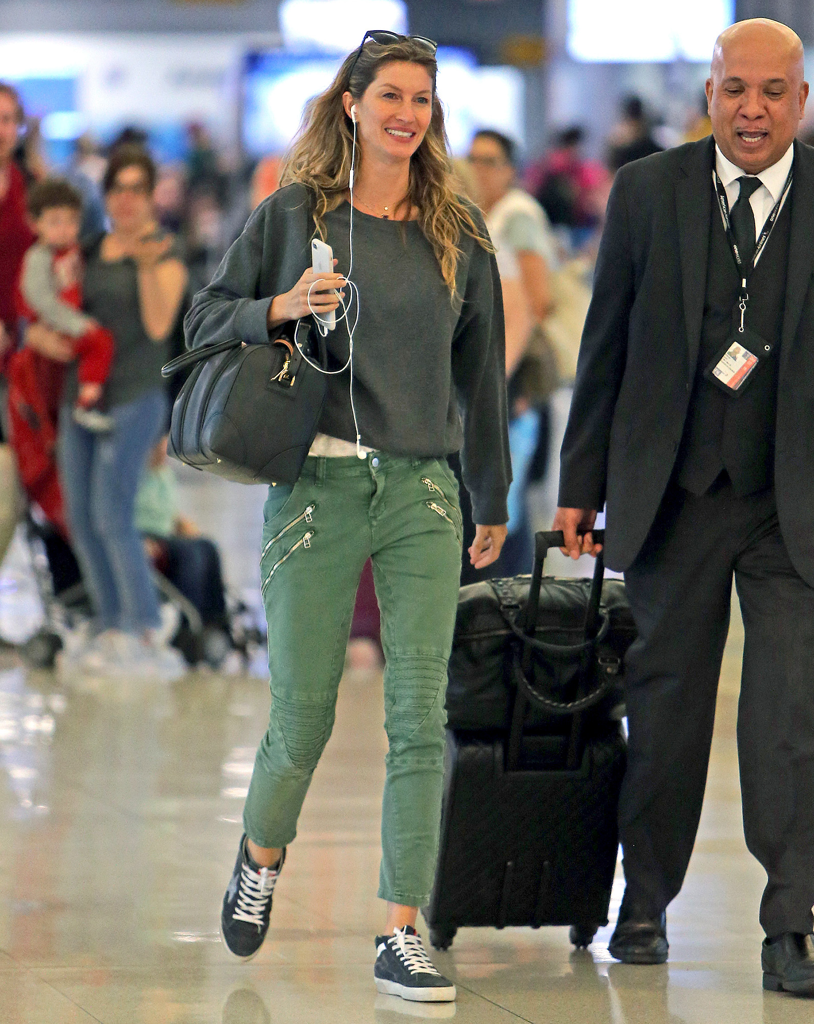 EXCLUSIVE: Fashion Icon Gisele Bundchen all smiles while joking with her greeter while touching down at JFK airport in New York for a connecting flight from Boston Massachusetts.